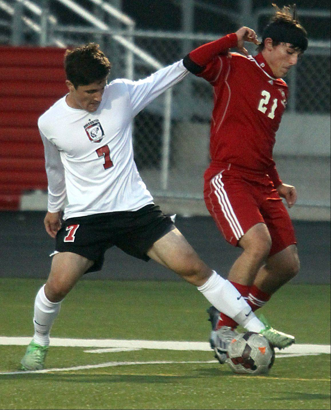 Barrington's Connor Hennelly, left, and Palatine's Brennan Harding battle for possession at Barrington on Monday night.