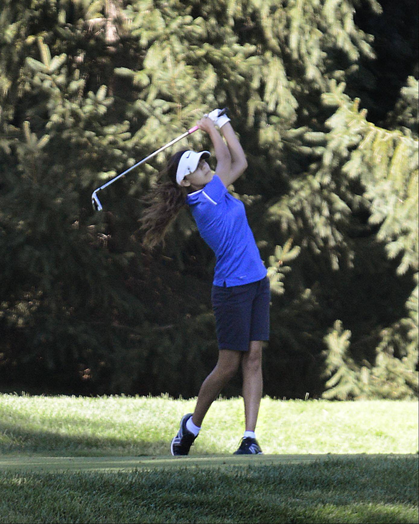Burlington Central's Jenna Kurosky tees off on No. 9 Monday at the Elgin Country Club girls golf invitational.