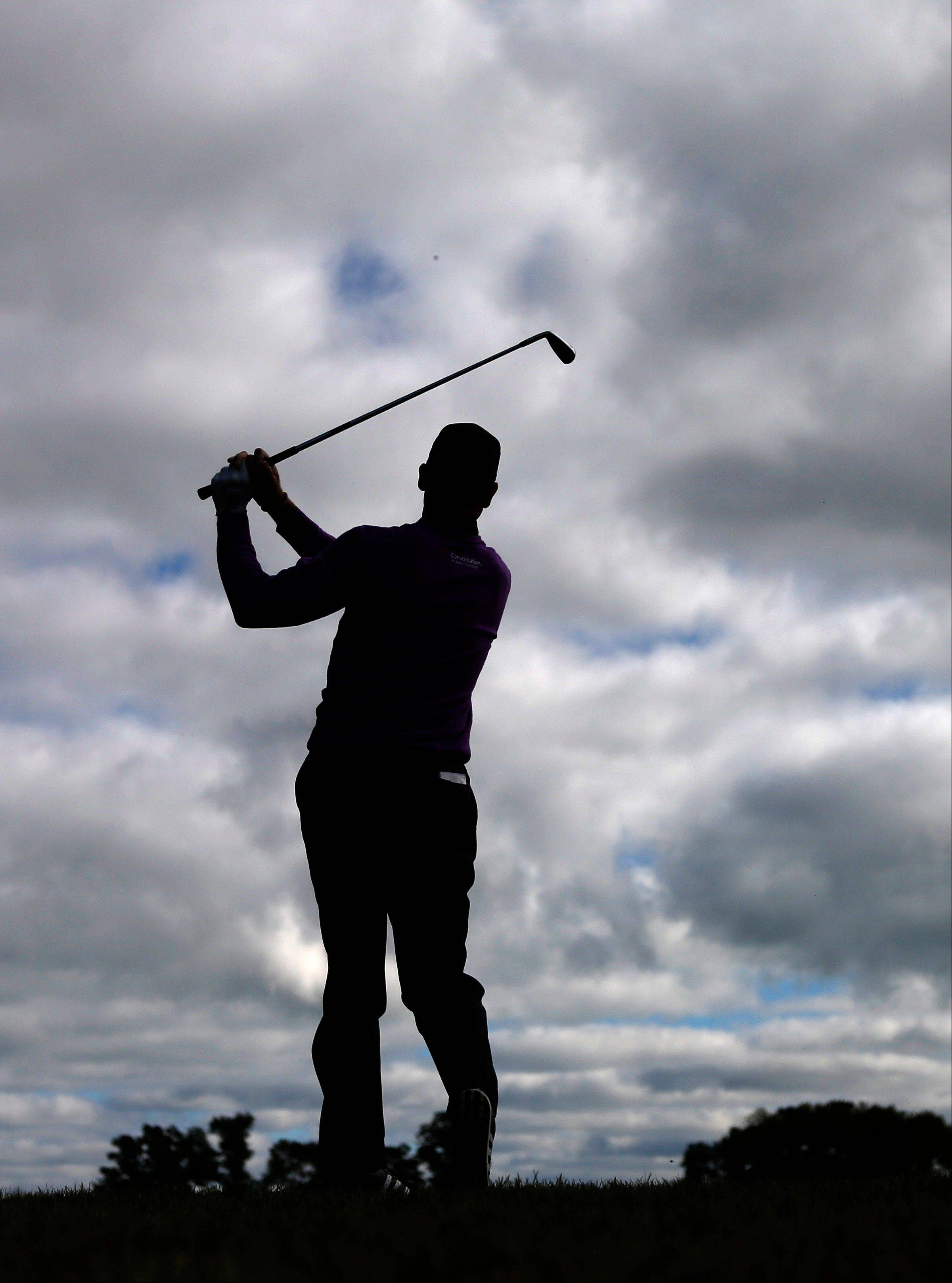 Jim Furyk is silhouetted after hitting his approach shot on the third fairway during the final round of the BMW Championship golf tournament at Conway Farms Golf Club Monday. Furyk had the lead entering the final round but finished in third place.