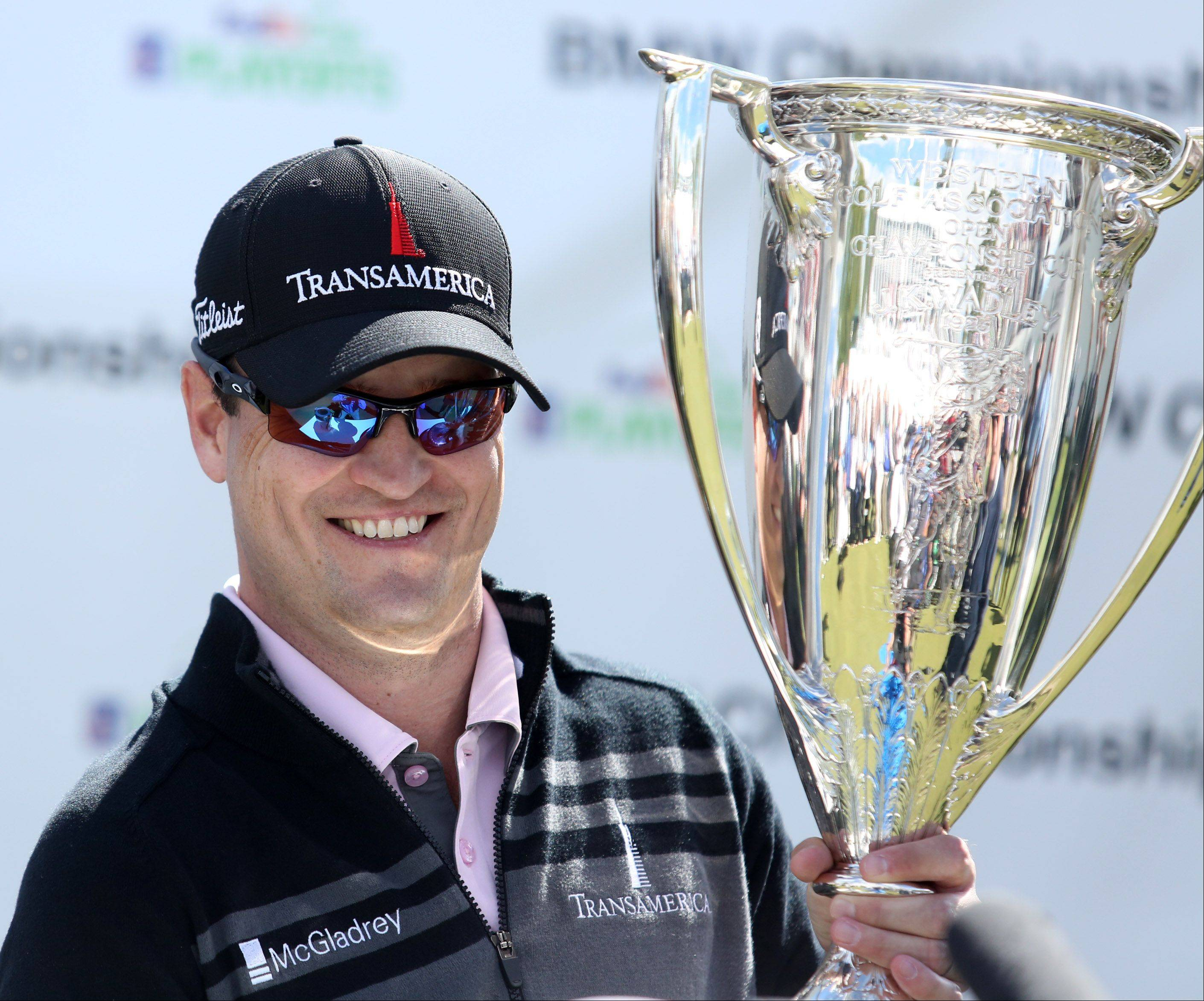 Zach Johnson holds the J.K. Wadley Trophy after winning the BMW Championship at Conway Farms Golf Club in Lake Forest on Monday.