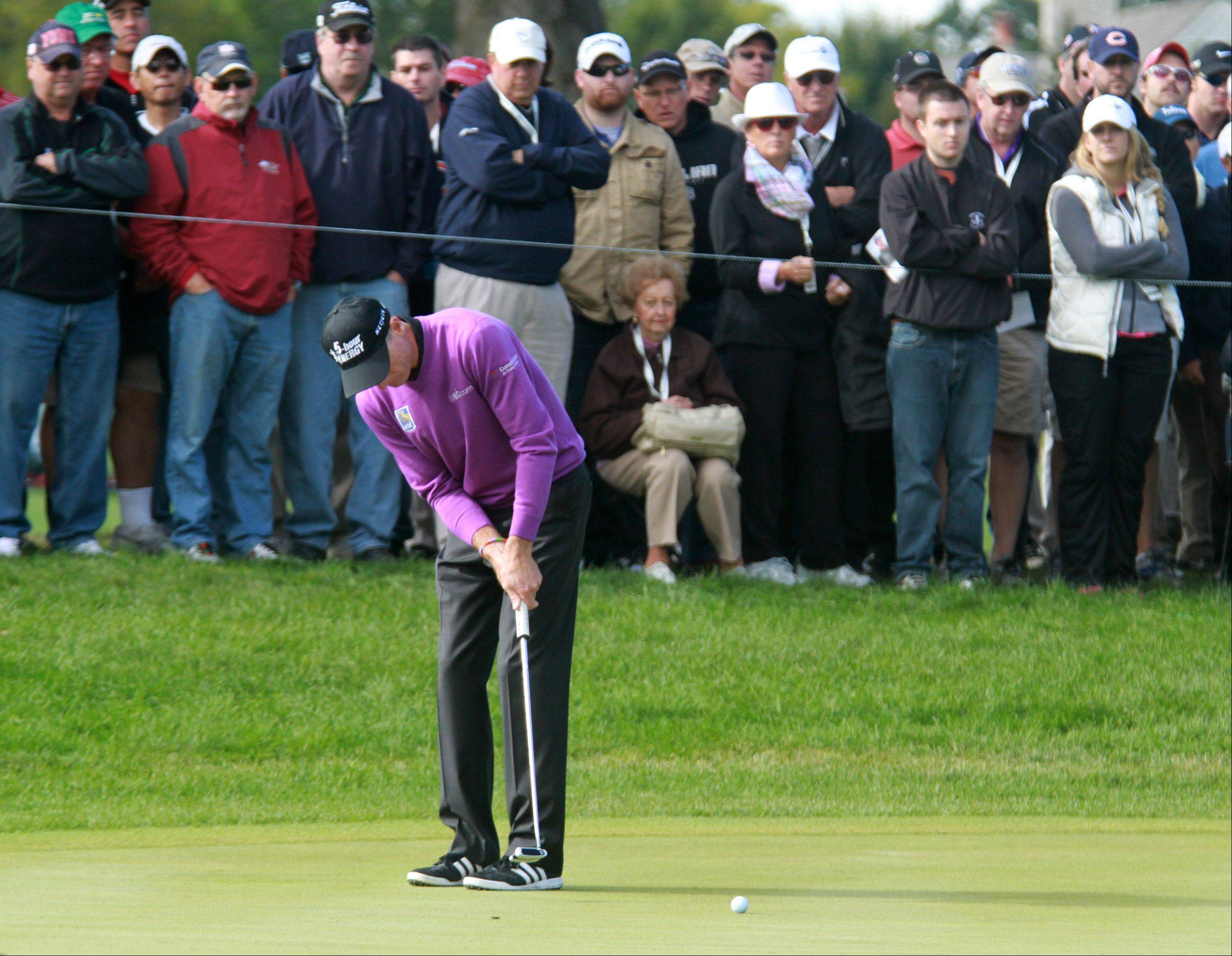 Jim Furyk putts on the 2nd hole.