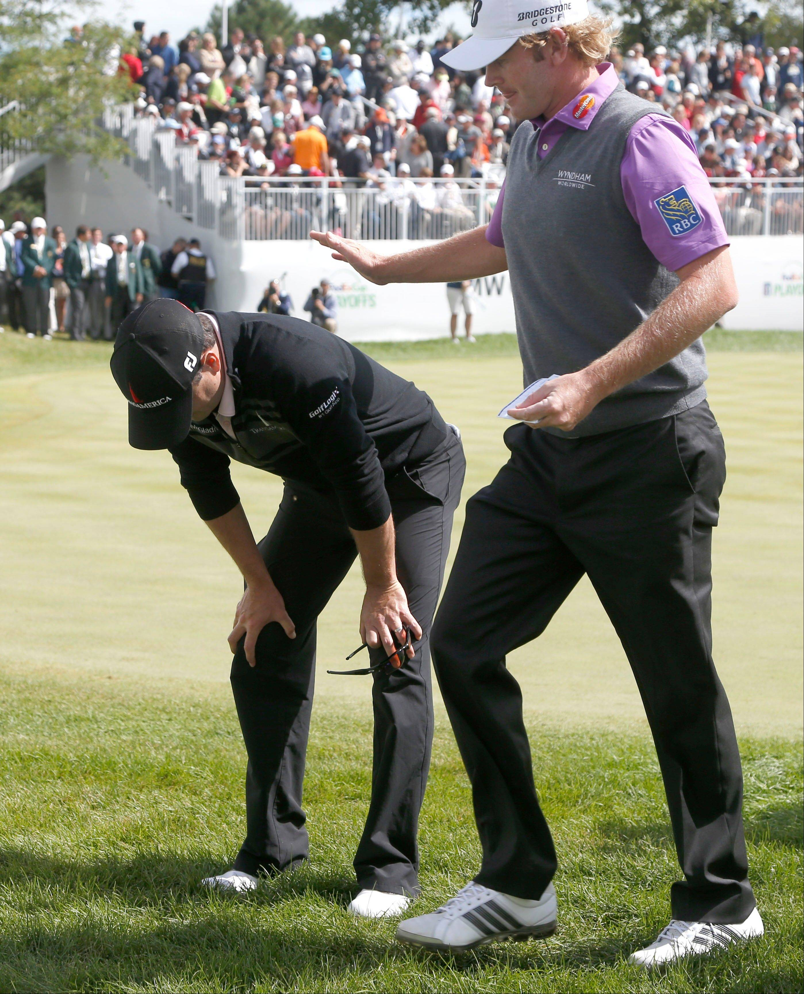 Brandt Snedeker, right, pats Zach Johnson on the back after Johnson won the BMW Championship golf tournament.
