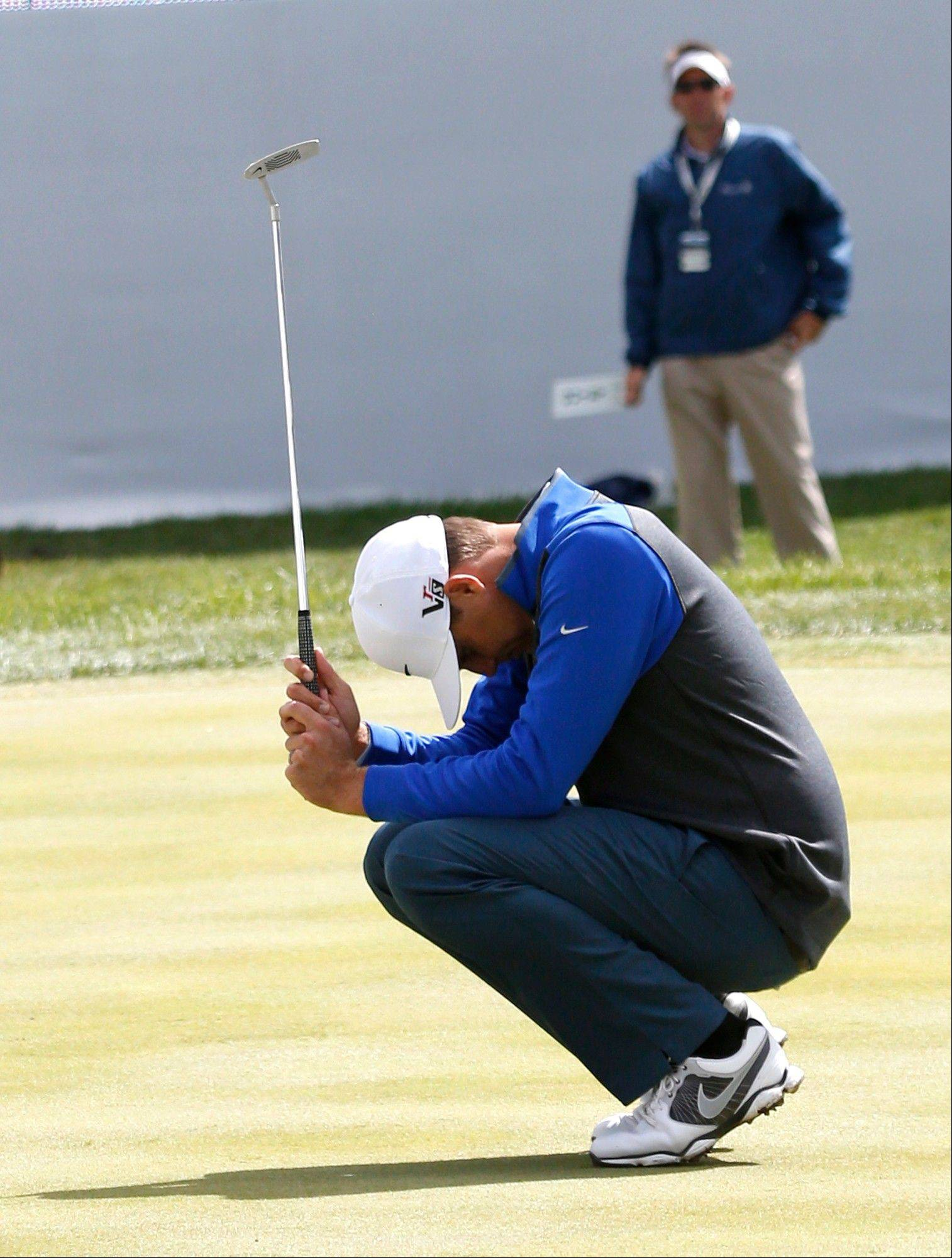 Nick Watney reacts after missing a birdie attempt on the 18th green.