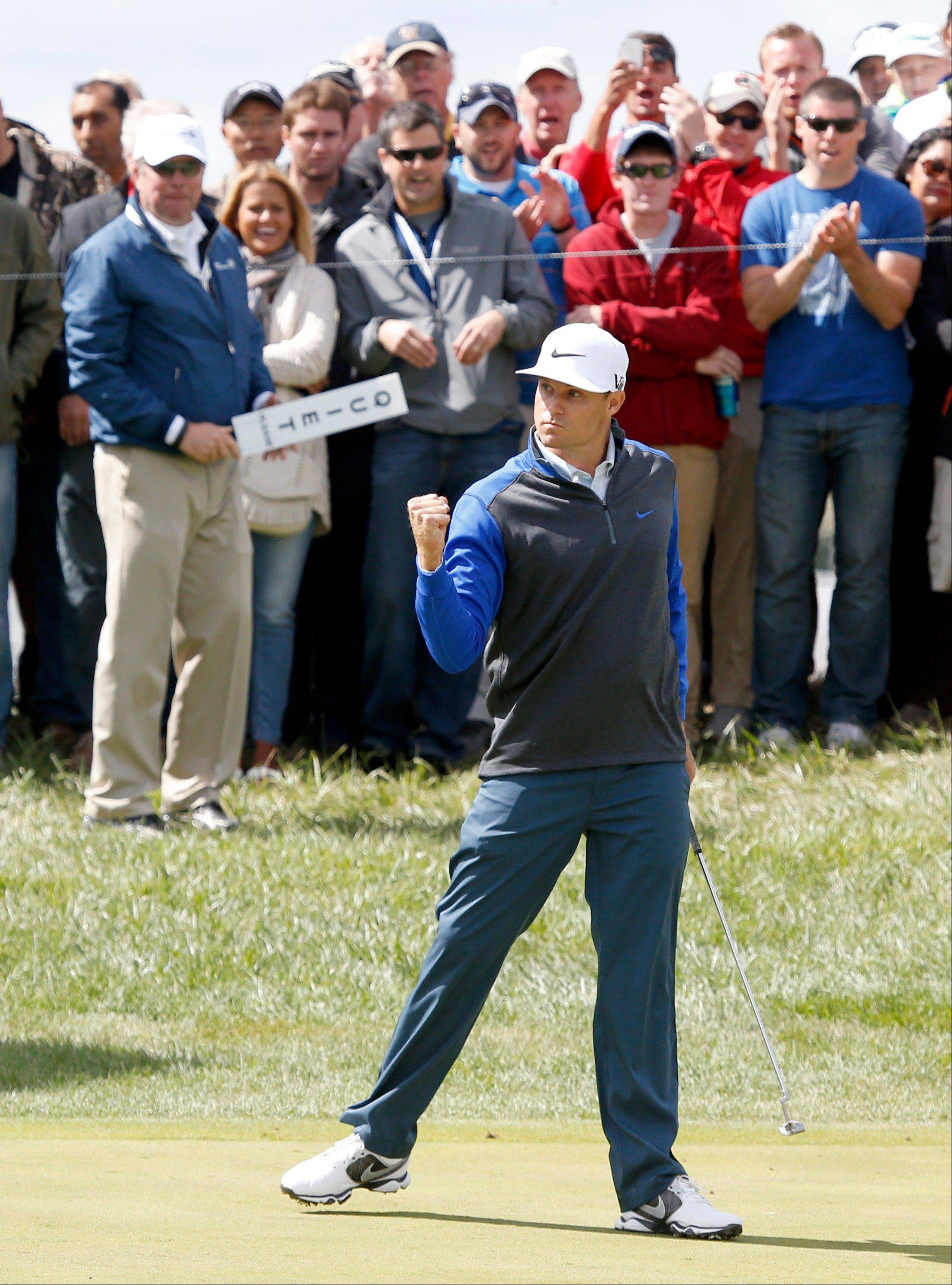 Nick Watney pumps his fist after making a birdie on the 17th green.