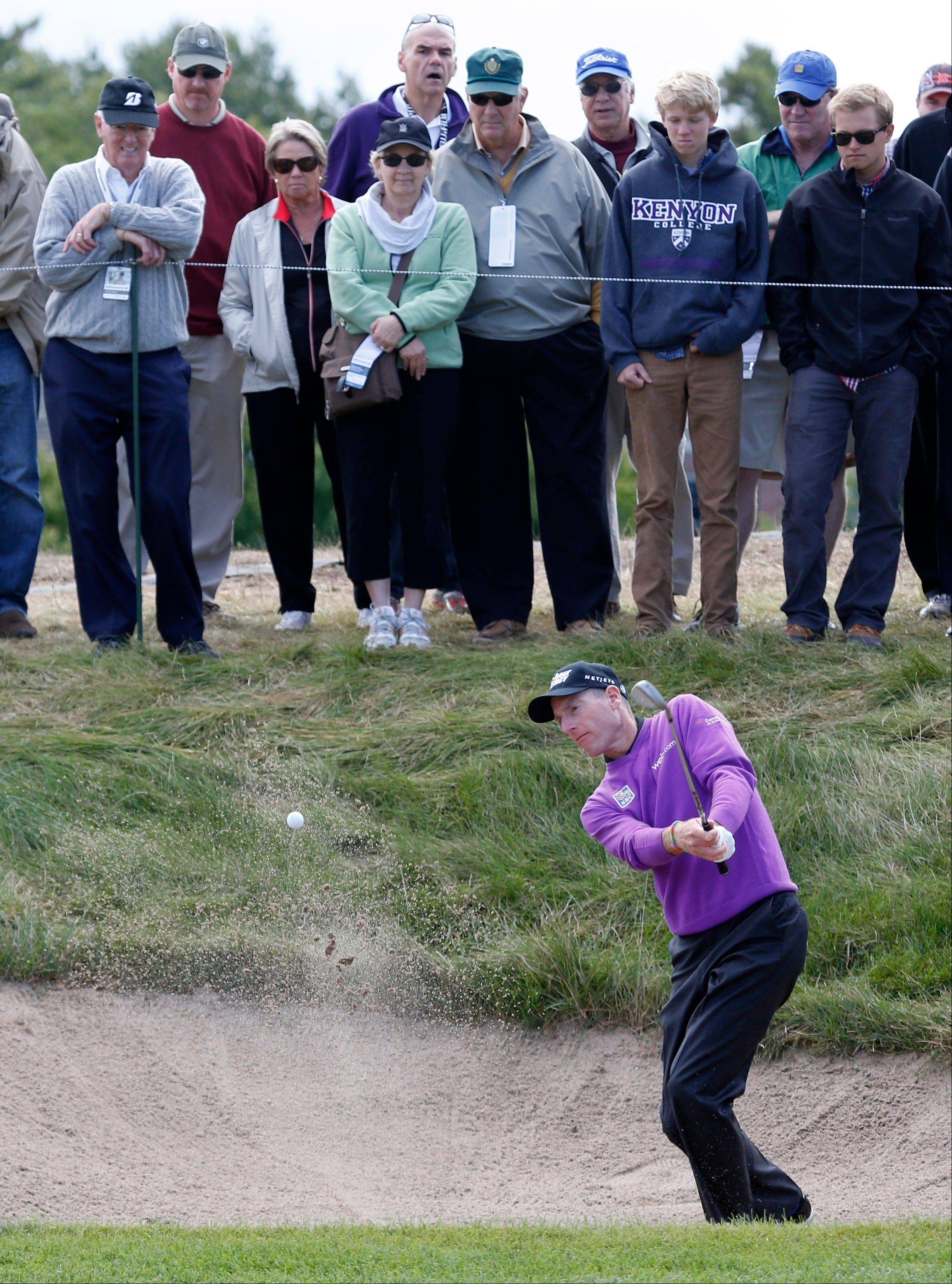 Jim Furyk hits out of the sand on the 3rd hole.