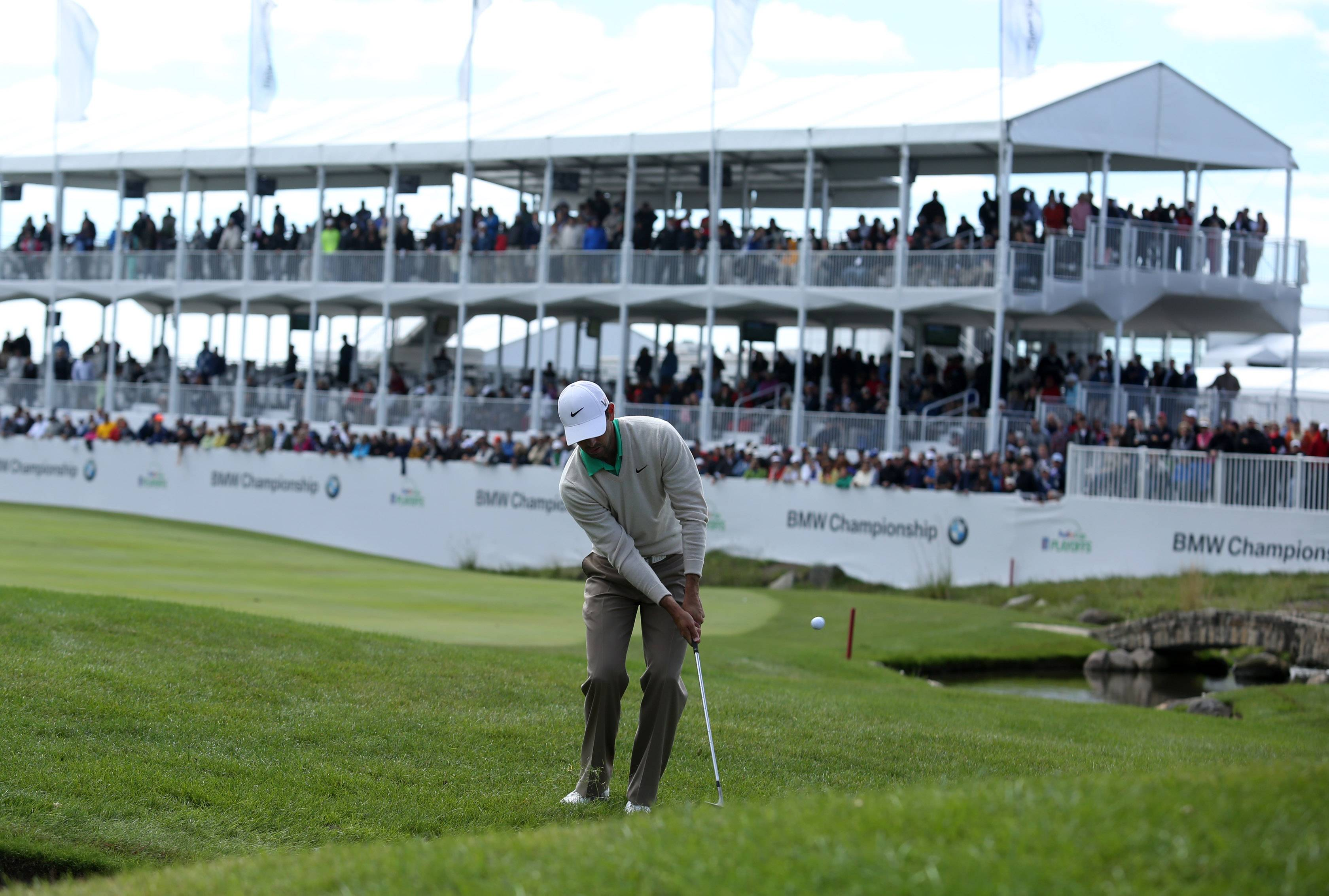 Charl Schwartzel swings from the 18th fairway.