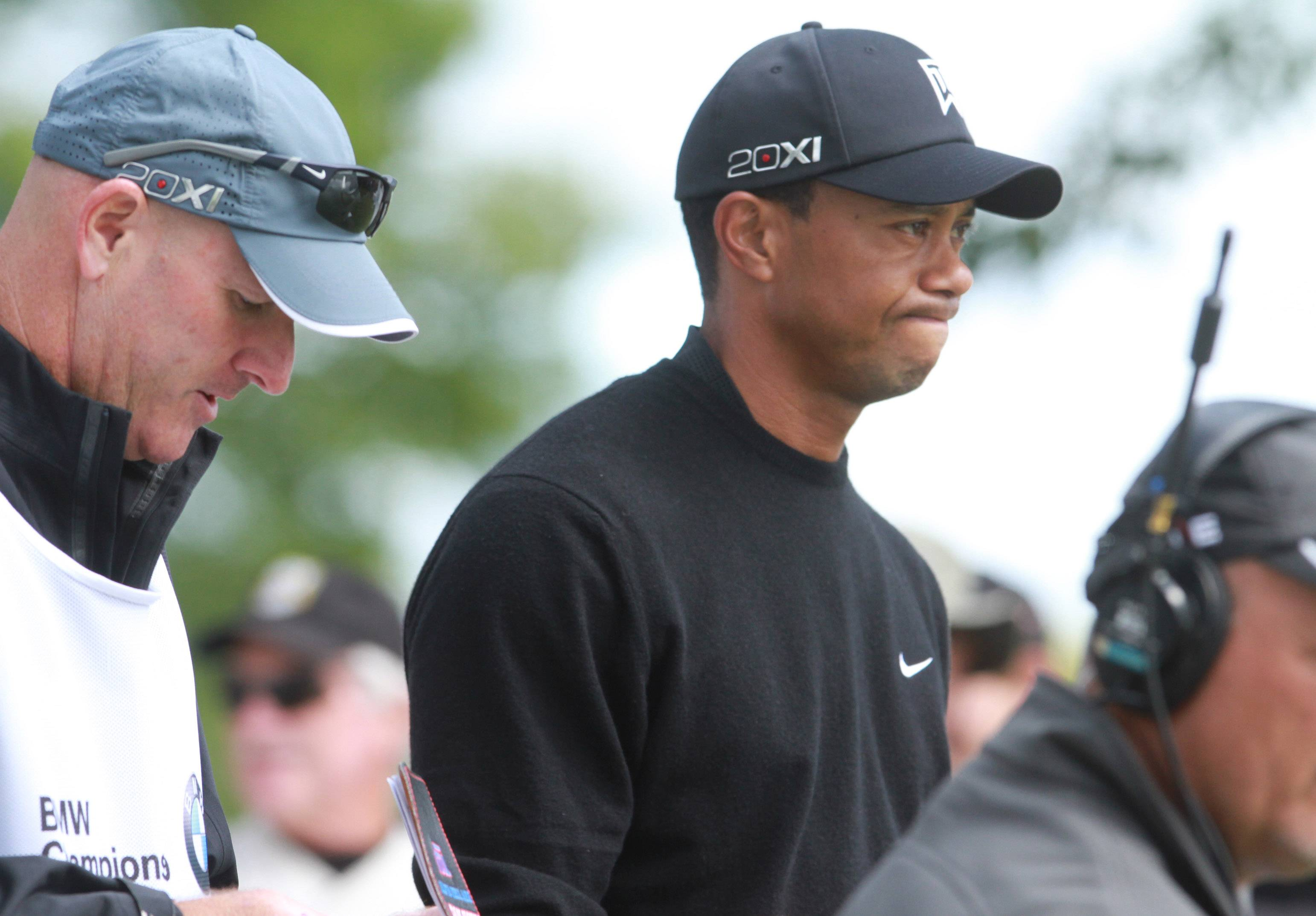 Tiger Woods reacts after teeing off on the 10th hole.