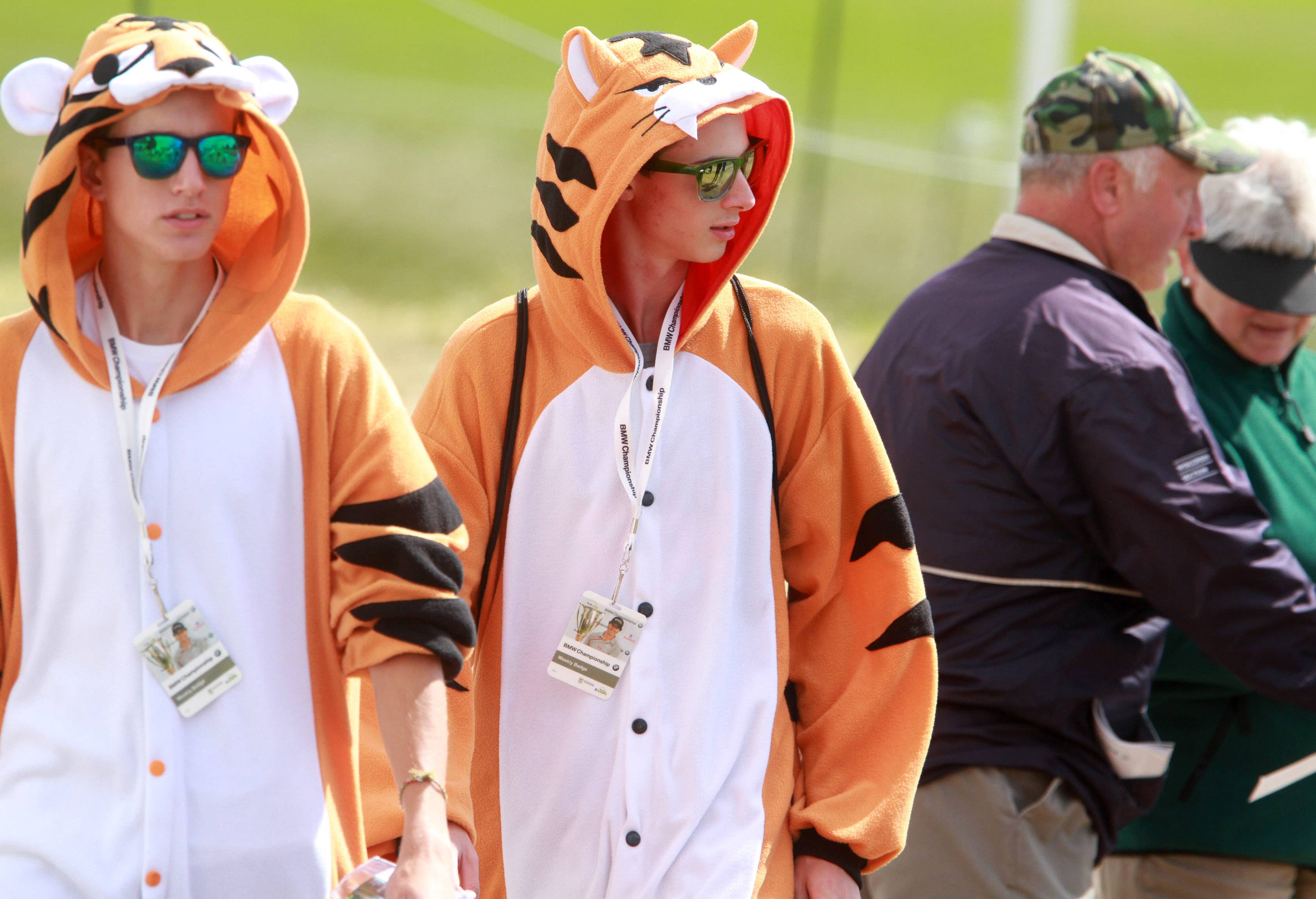 Tiger Woods fans sport costumes on Monday.
