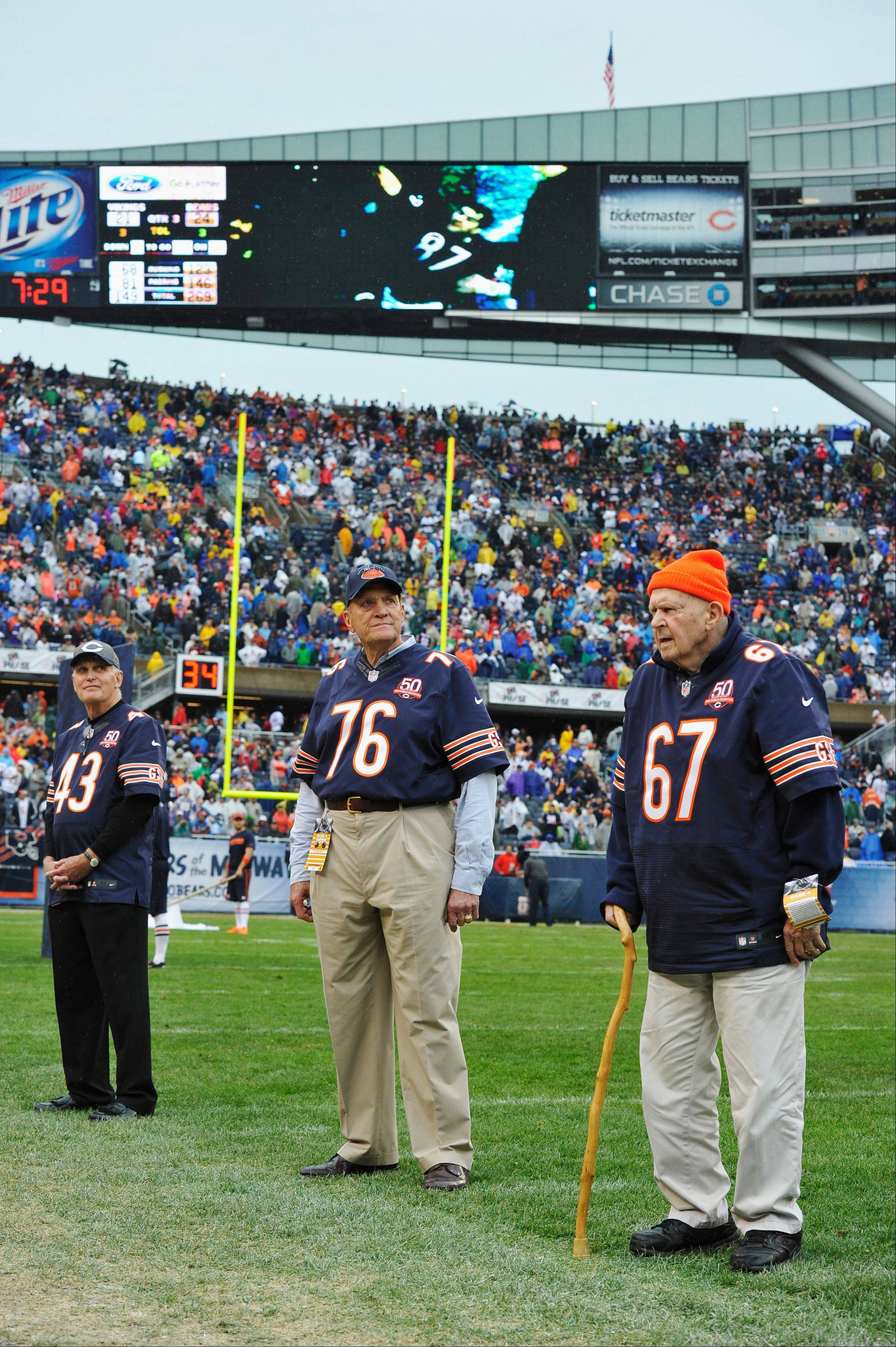 Former Chicago Bears players cornerback Larry Glueck (43), defensive tackle John Johnson (76) and offensive guard Ted Karras (67) were honored at halftime of Sunday's Bears-Vikings game to celebrate thier NFL Championship over the New York Giants 50 years ago.