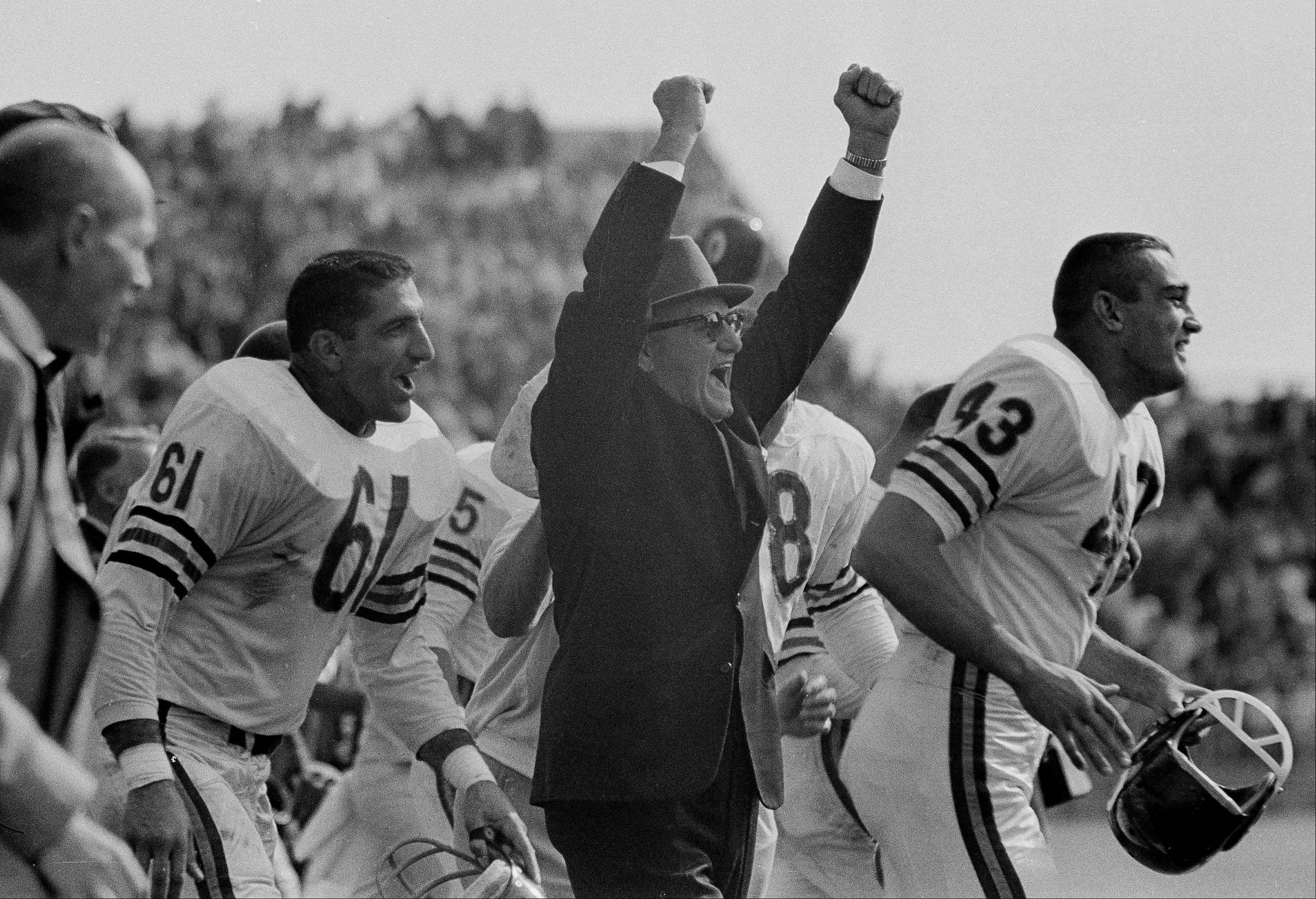 Chicago Bears head coach George Halas and linebacker Bill George celebrate the last second of the game as their team defeated the Green Bay Packers, 10-3, on Sept. 15, 1963. The Bears went on to win the 1963 NFL title over the New York Giants.