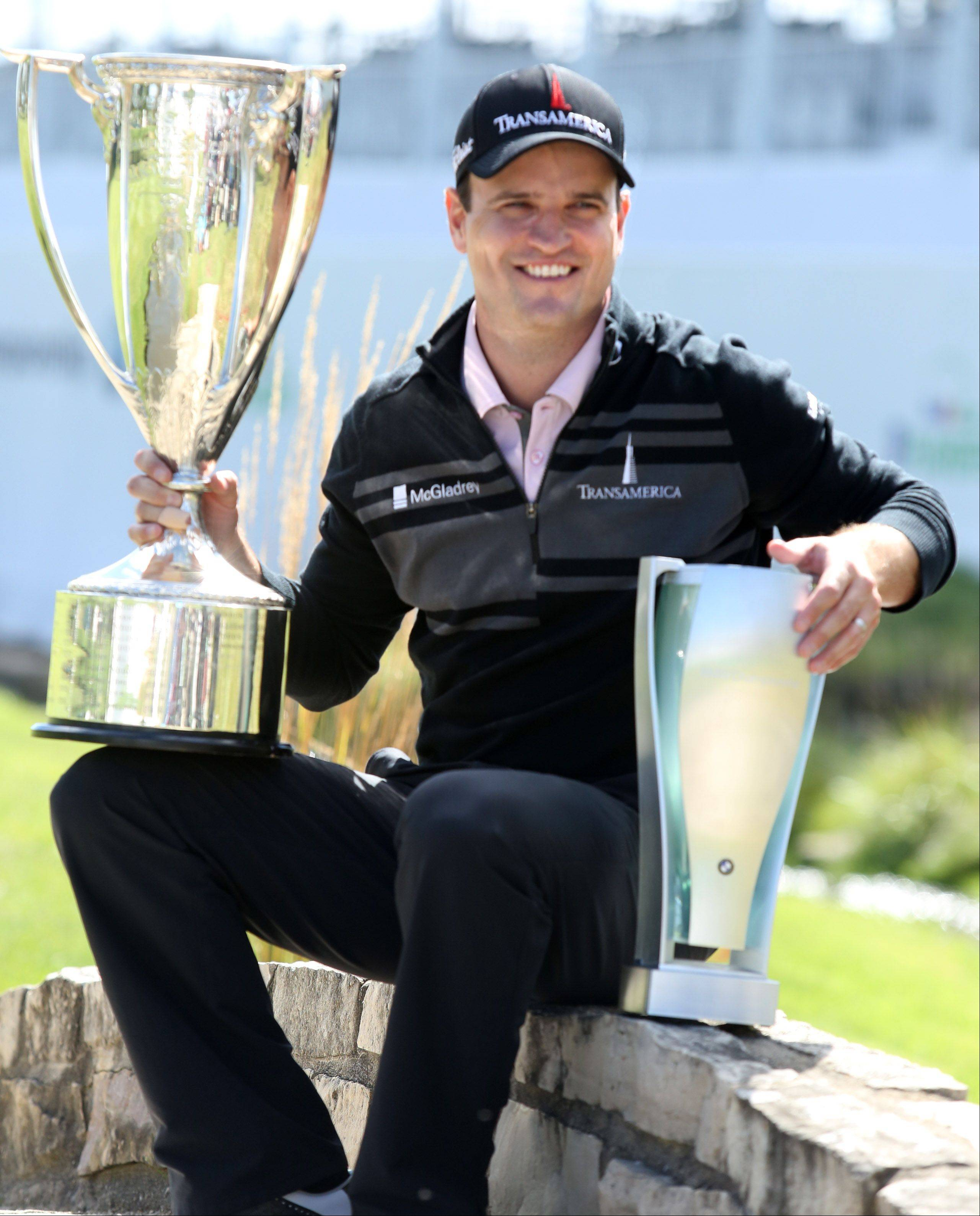Zach Johnson with the J.K. Wadley Trophy, left, and the BWM Trophy after winning the BMW Championship at Conway Farms Golf Club in Lake Forest on Monday. The Wadley is awarded by the Western Golf Association.