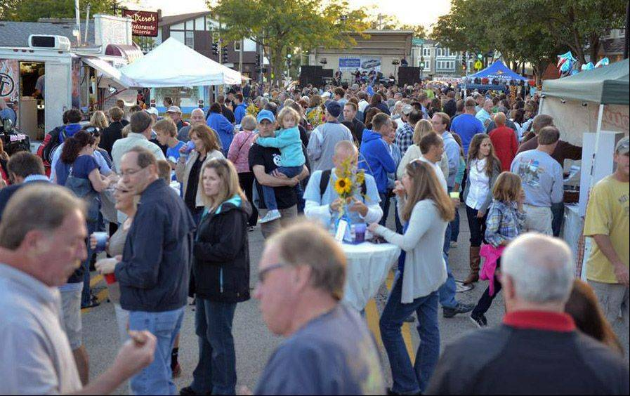 Bigger-than-anticipated crowds hit downtown Lake Zurich on Saturday for the inaugural Rock the Block street party.
