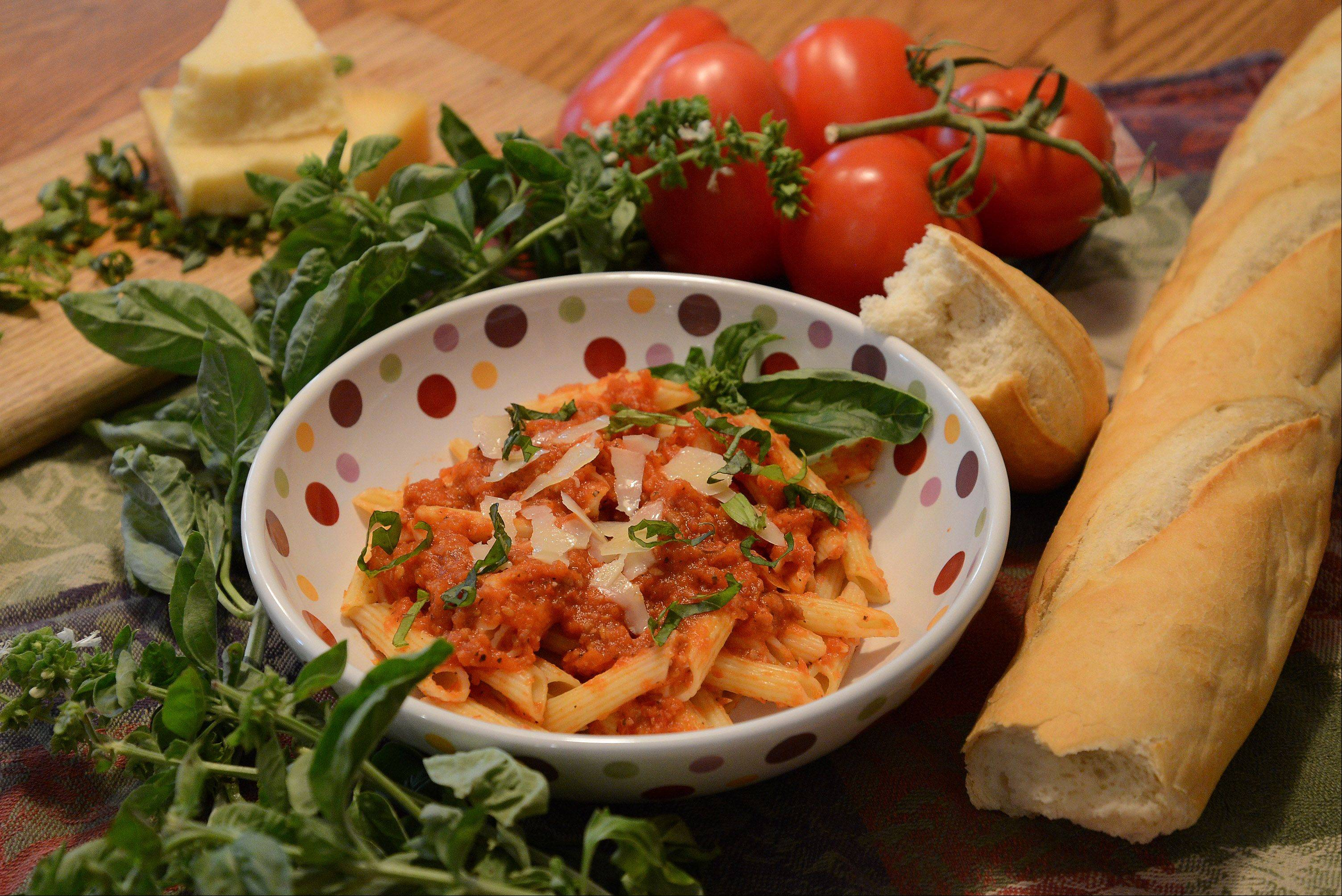 Roasted tomatoes that you don't have to peel make this arrabbiata sauce easy and delicious. Try it with penne pasta.