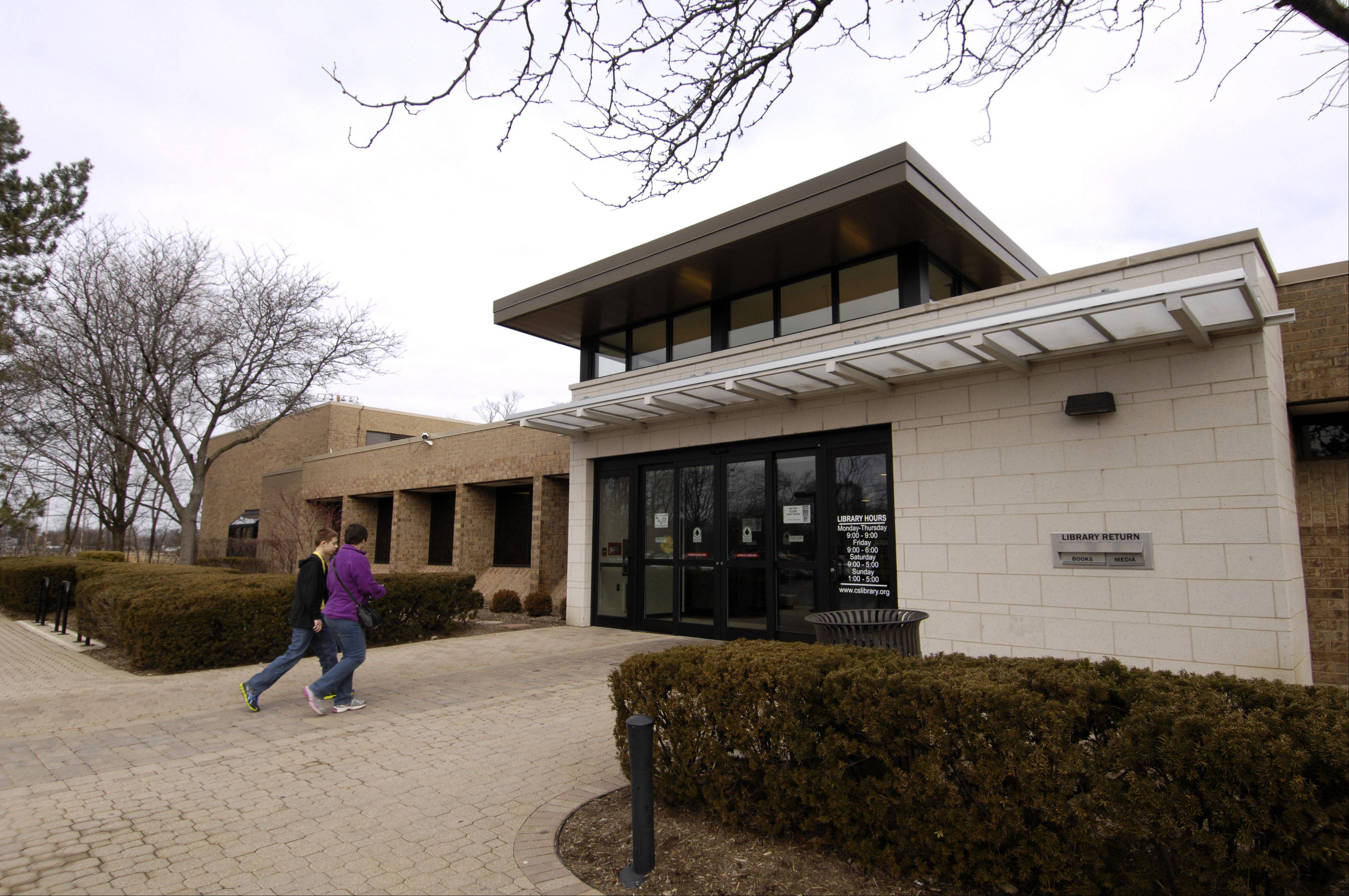 Carol Stream Public Library trustees favor keeping a new site that someday could house a replacement for their old library, seen here, and be a park for now.