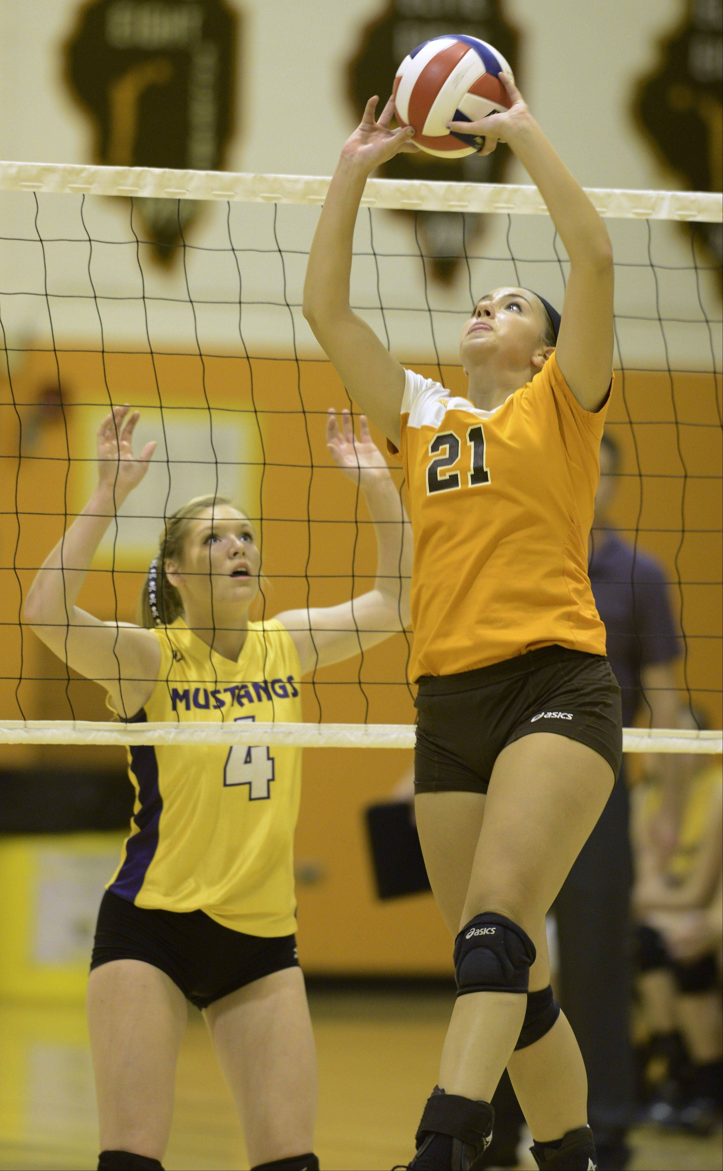 Hersey�s Courtney Stedman sets the ball as Rolling Meadows� Lauren Sokolowski stands ready at the net during Tuesday�s match in Arlington Heights.