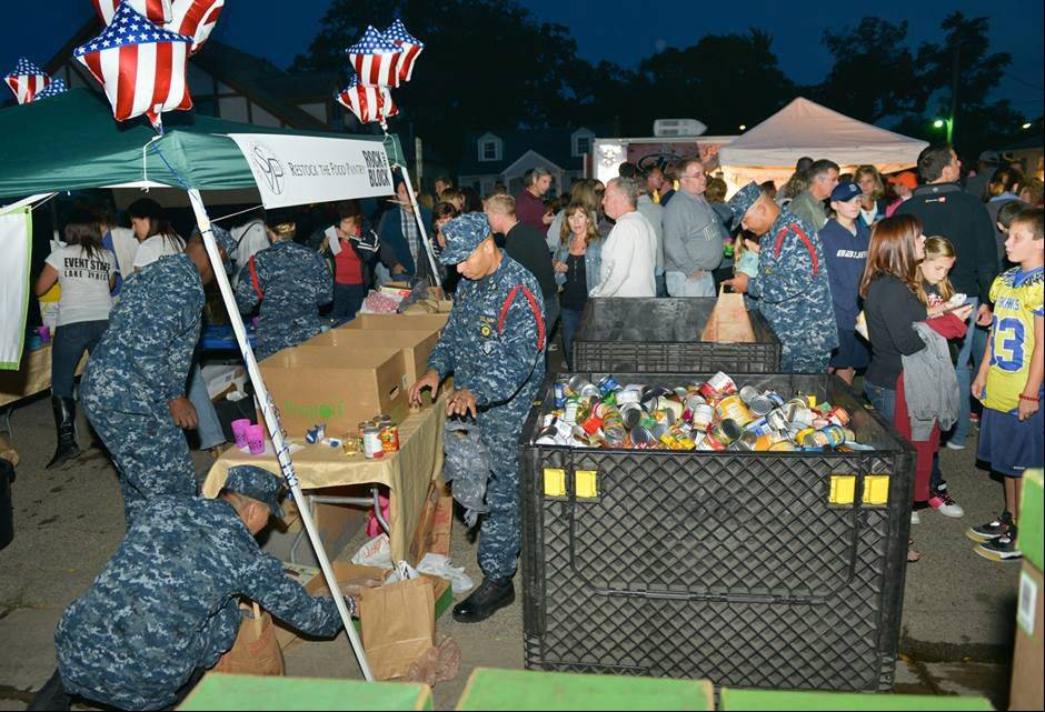At least 3,000 cans of food for a local pantry were collected at last Saturday's inaugural Rock the Block in downtown Lake Zurich. Great Lakes Naval Station personnel helped to collect the food at a tent.