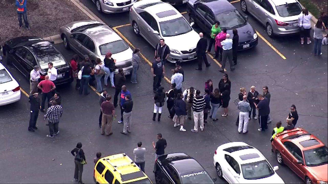 COURTESY OF ABC7ComEd employees are show in the parking lot after a misunderstanding over a routine fire drill lead to a 911 call and a large police response Tuesday at a ComEd building in Oakbrook.