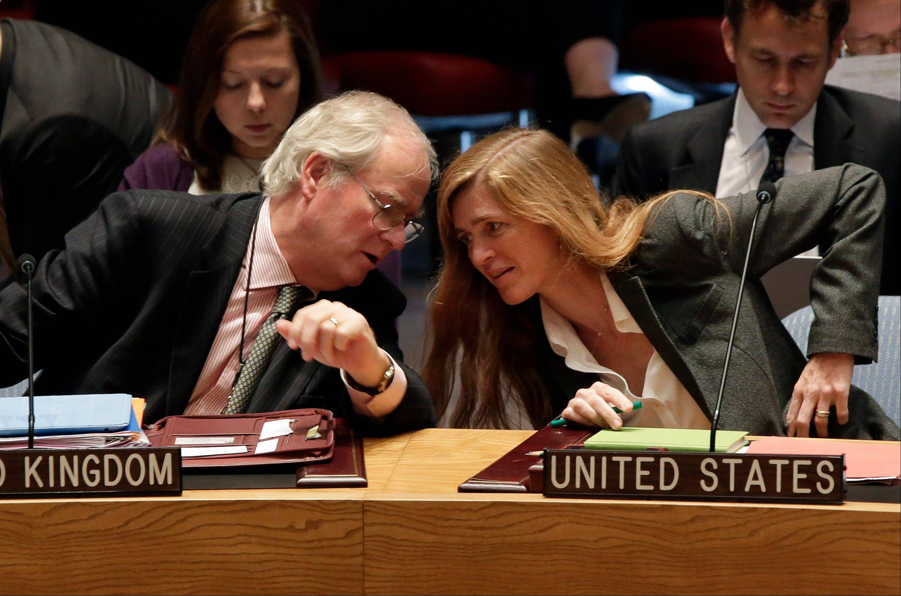 British Ambassador Mark Lyall Grant and U.S. Ambassador Samantha Power confer in the U.N. Security Council on Tuesday. Moscow insisted a new Security Council resolution on Syria not allow the use of force.