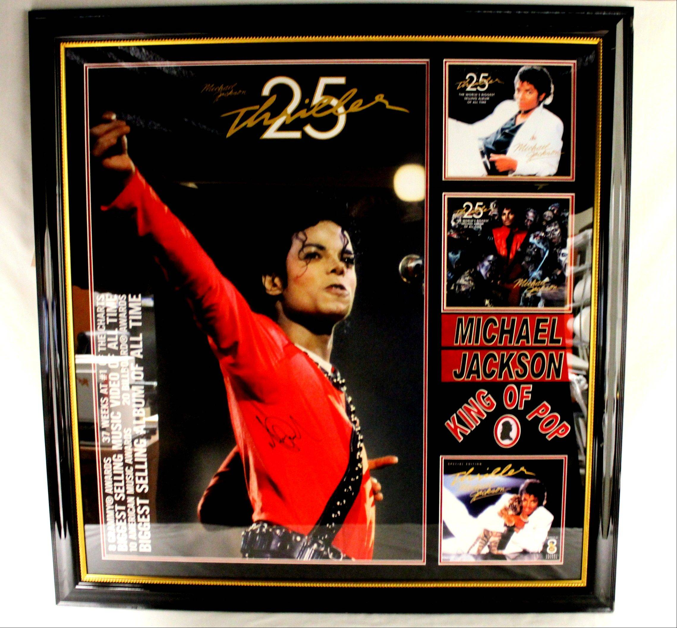 "This undated photo provided by Texas-based Gaston & Sheehan Auctioneers, Inc. shows a Michael Jackson autographed poster from the 25th anniversary of ""Thriller"" that once belonged to former Illinois Congressman Jesse Jackson Jr. It is among the items the U.S. Marshals Service started selling in an online auction Tuesday in its attempt to recoup part of the $750,000 in campaign funds the Chicago Democrat and his wife illegally spent."