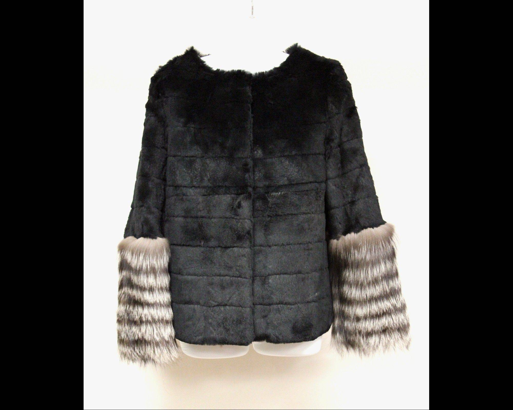 This undated photo provided by Texas-based Gaston & Sheehan Auctioneers, Inc. shows a woman's mink jacket with silver-fox sleeves that once belonged to former Illinois Congressman Jesse Jackson Jr. and his wife Sandi. It is among the items U.S. Marshals Service started selling in an online auction Tuesday in its attempt to recoup part of the $750,000 in campaign funds the Chicago Democrat and his wife illegally spent.