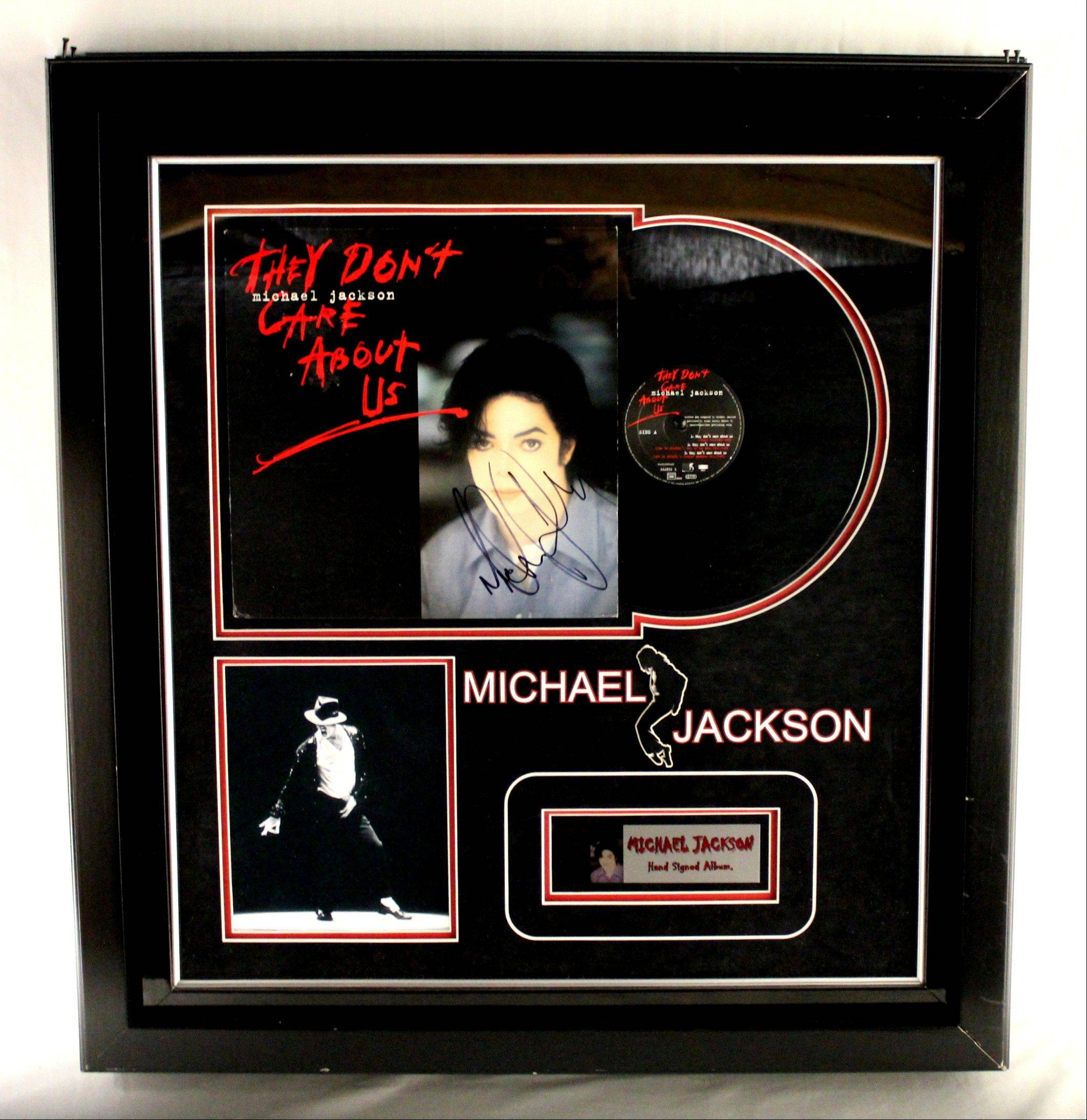 "This undated photo provided by Texas-based Gaston & Sheehan Auctioneers, Inc. shows a Michael Jackson autographed record album titled ""They Don't Care About Us"" that once belonged to former Illinois Congressman Jesse Jackson Jr. It is among the items the U.S. Marshals Service started selling in an online auction Tuesday in its attempt to recoup part of the $750,000 in campaign funds the Chicago Democrat and his wife illegally spent."
