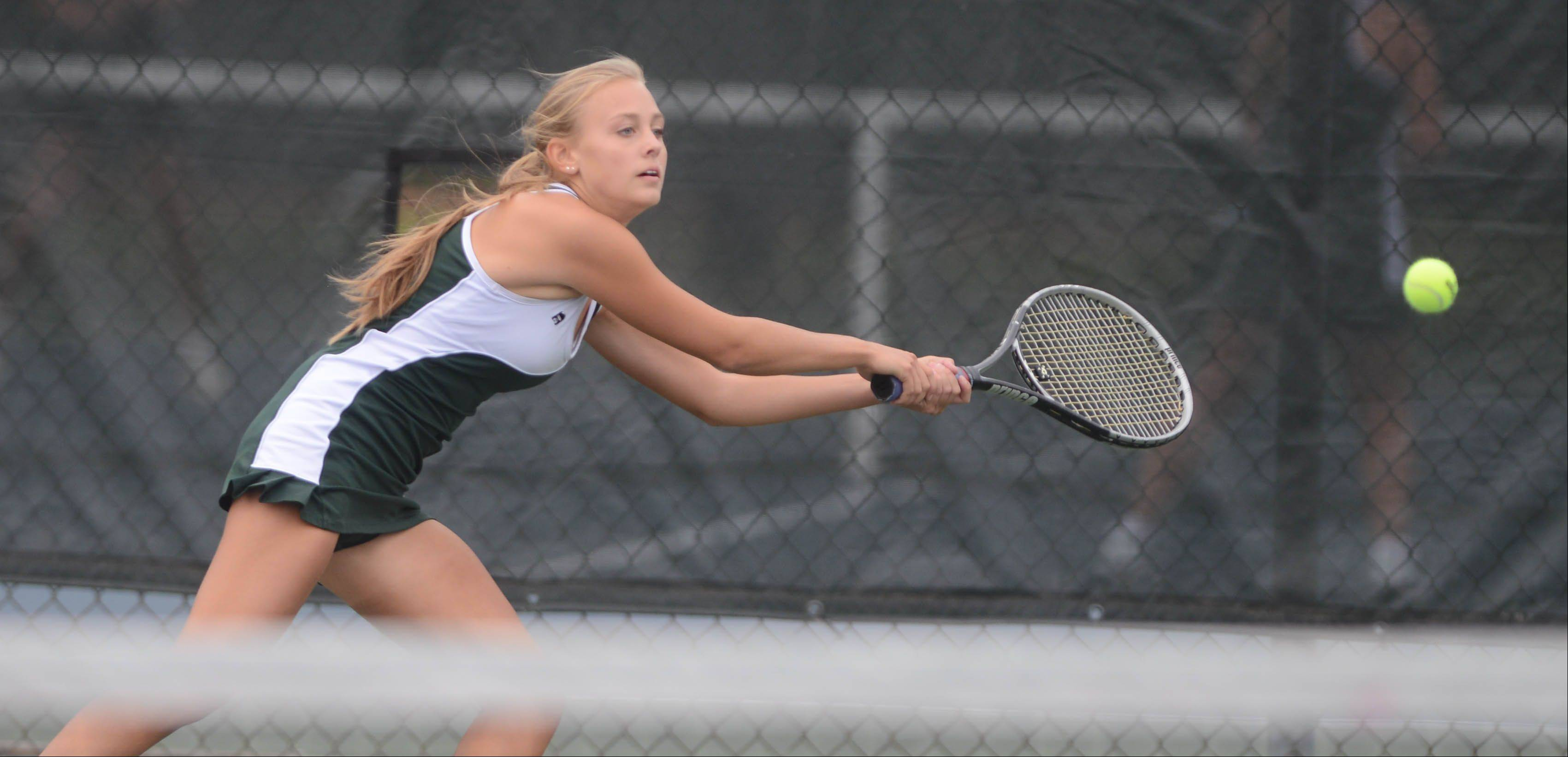 Amanda Glavin of Waubonsie reaches for a ball during the Metea Valley at Waubonsie Valley girls tennis match Tuesday.
