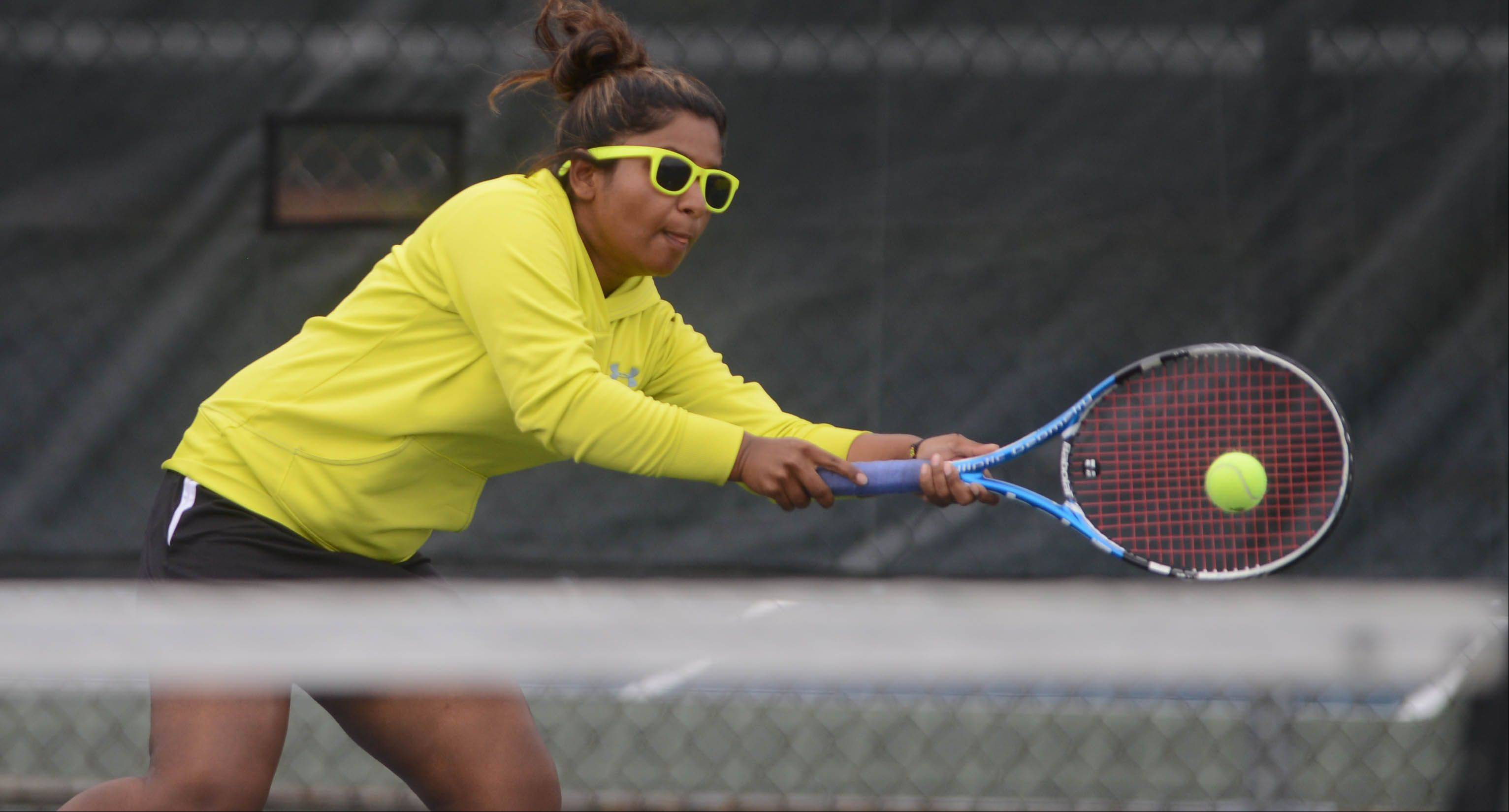 Nikki Beesetti of Metea Valley reaches for the ball during the Metea Valley at Waubonsie Valley girls tennis match Tuesday.