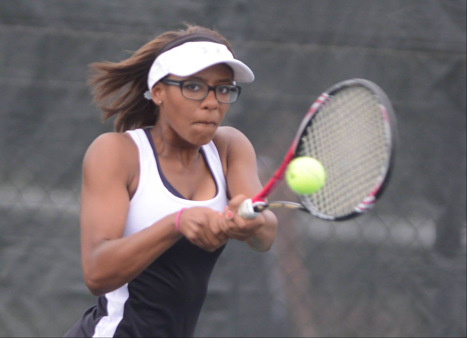Deja Hartsfield of Metea returns a ball during the Metea Valley at Waubonsie Valley girls tennis match Tuesday.