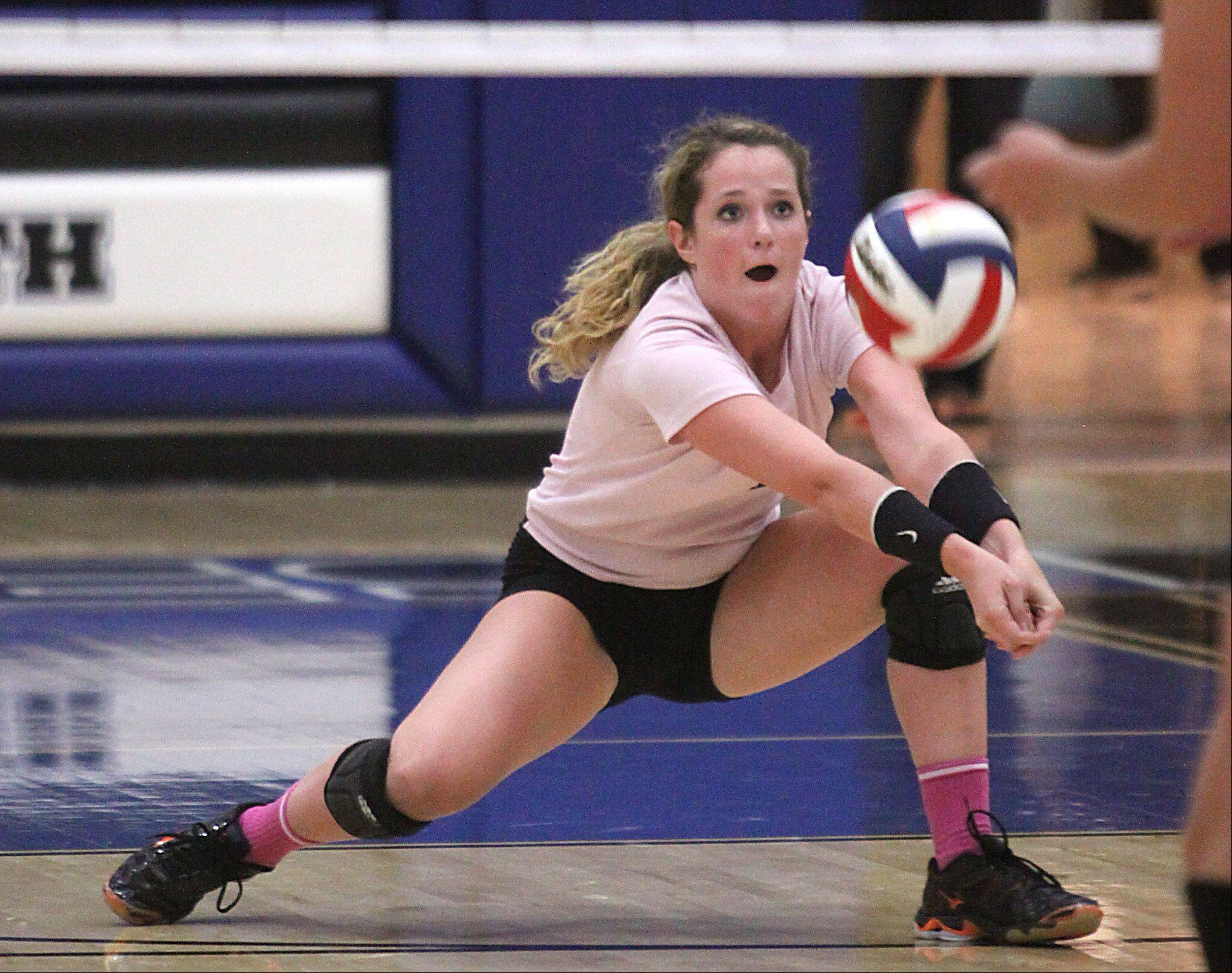 St. Charles East's Anne Hughes hits the ball during a varsity volleyball game at St. Charles North on Tuesday evening.