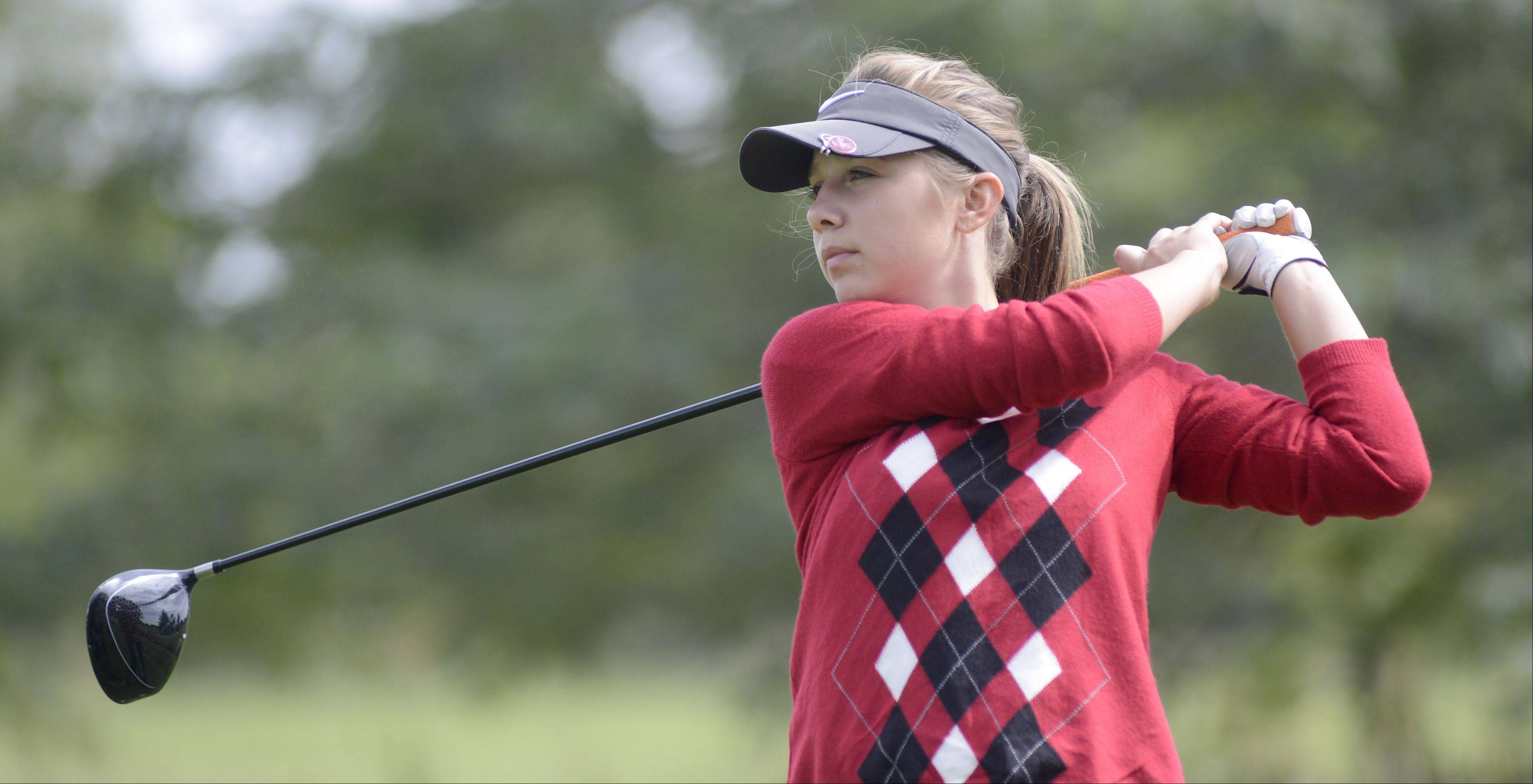 Huntley's Gillian Young tees off at the fourth hole of the Vallye course at Boone Creek Golf Club in McHenry on Tuesday.