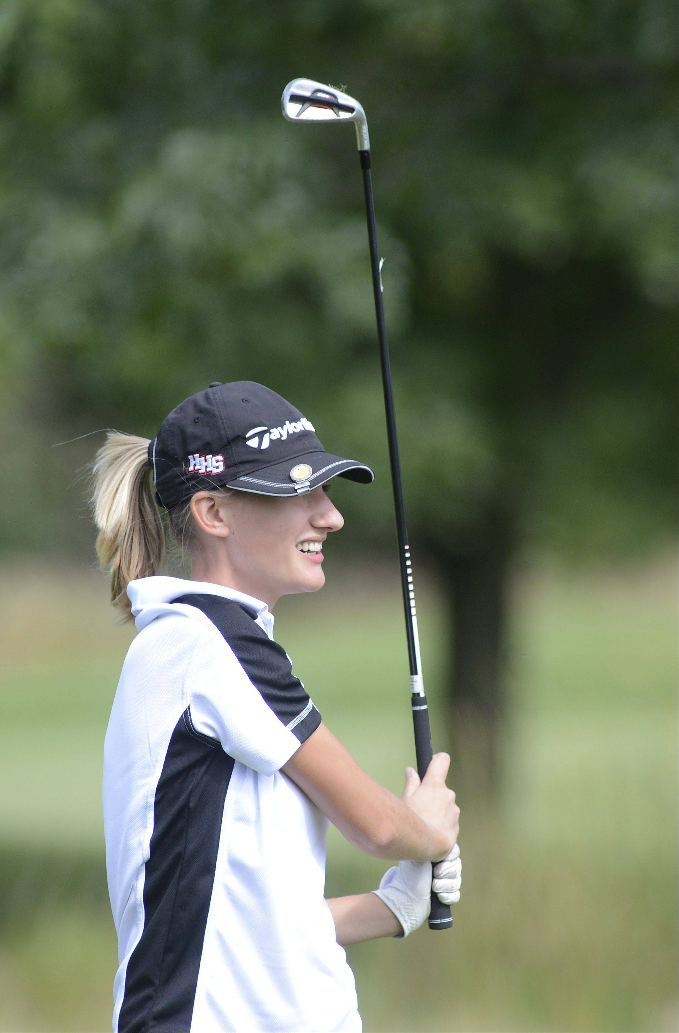 Huntley's Zoe Dowell tees off at the fifth hole of the Valley course at Boone Creek Golf Club in McHenry on Tuesday.