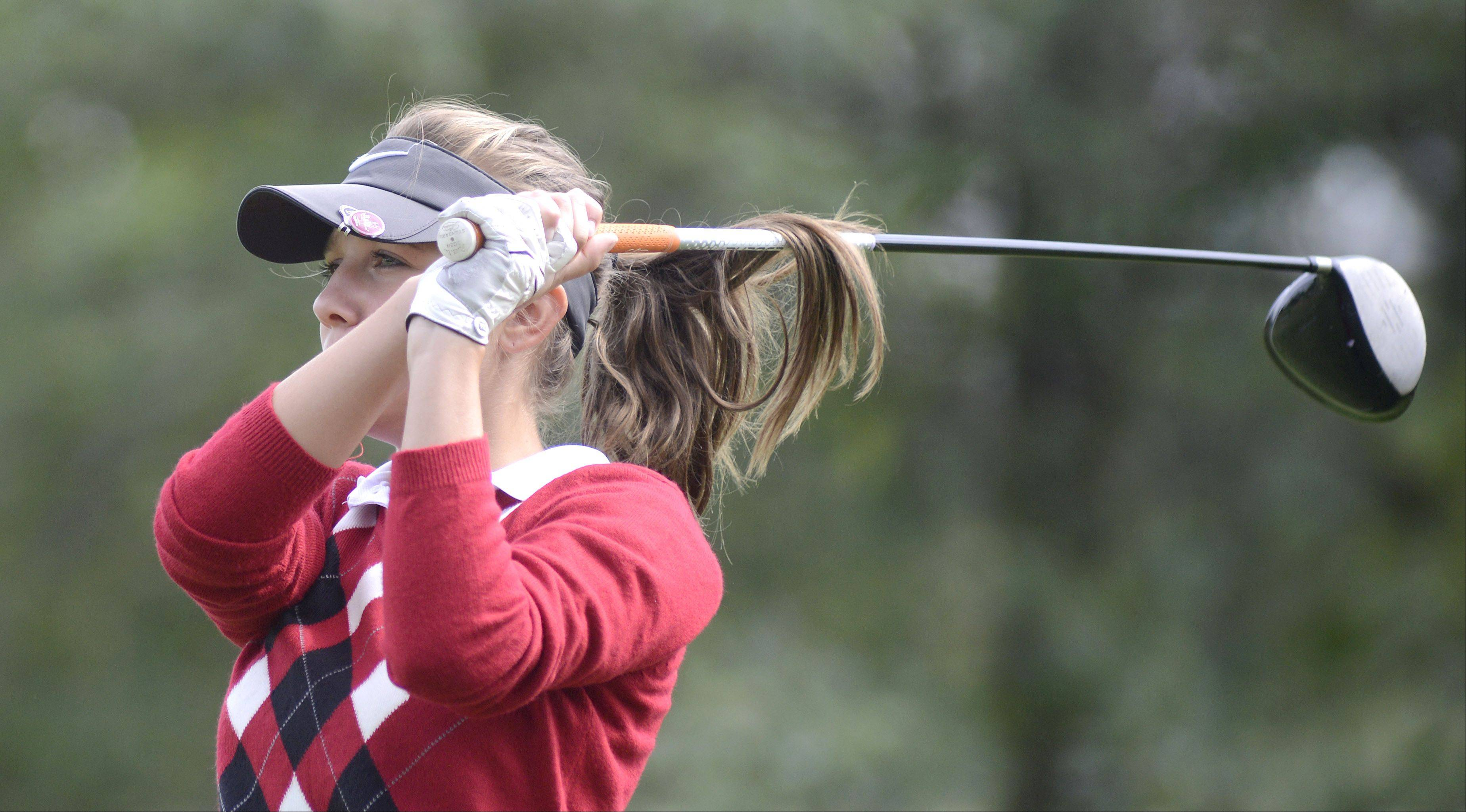 Huntley's Gillian Young tees off at the fourth hole of the Valley course at Boone Creek Golf Club in McHenry on Tuesday.