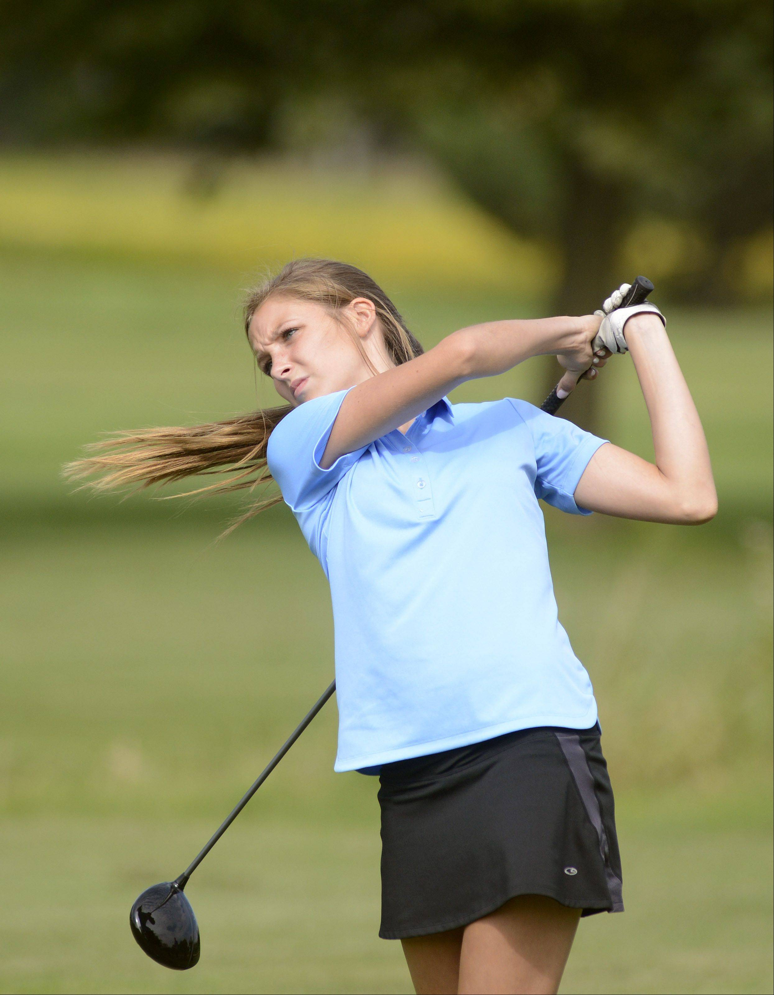 Jacobs' Sydney Goll tees off at the eighth hole on the Prairie course at Boone Creek Golf Club in McHenry on Tuesday.