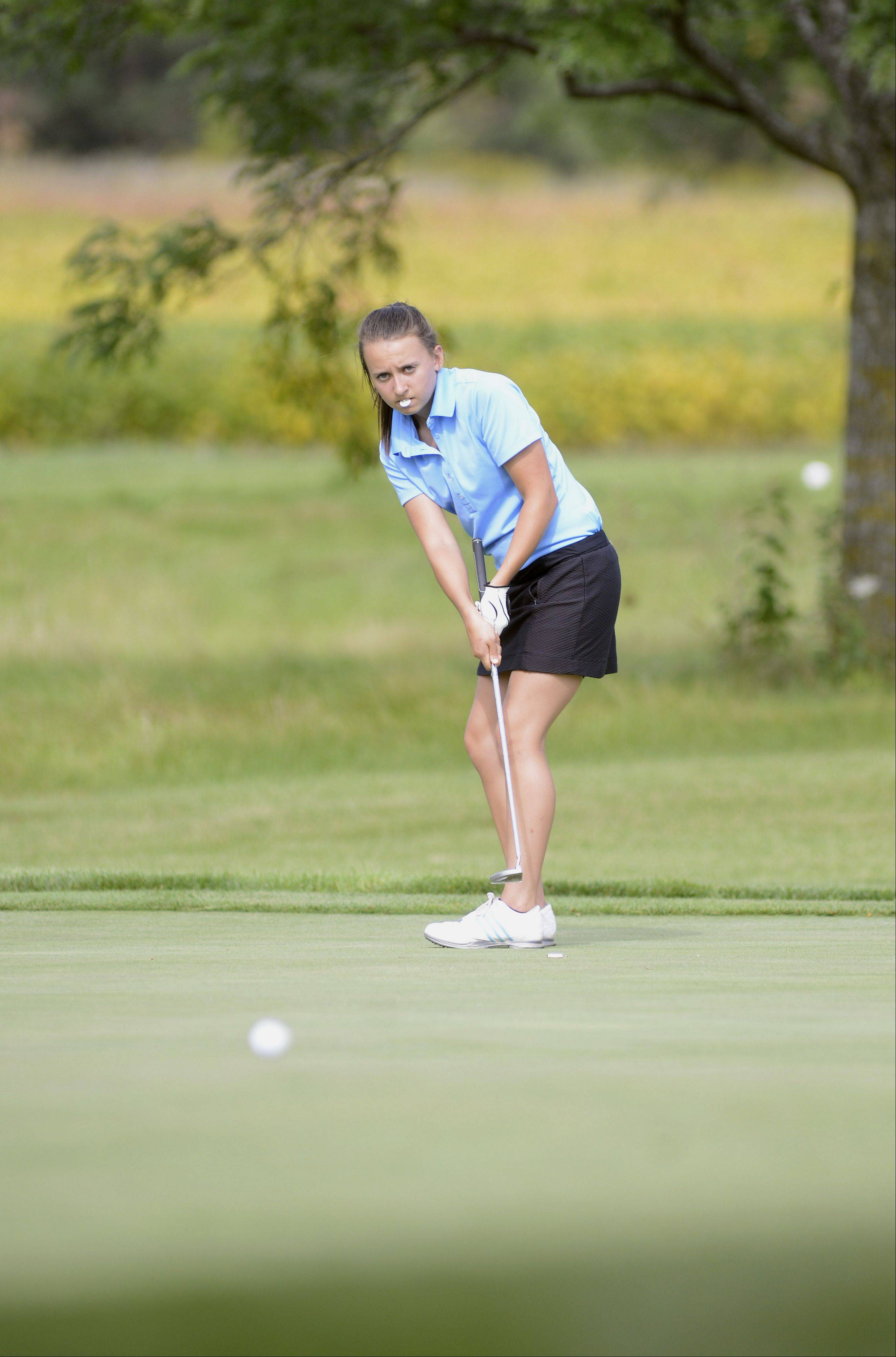 Jacobs' Julia Beaugureau watches her ball curve as it rolls toward the hole of the eighth green of the Prairie course at Boone Creek Golf Club in McHenry on Tuesday.