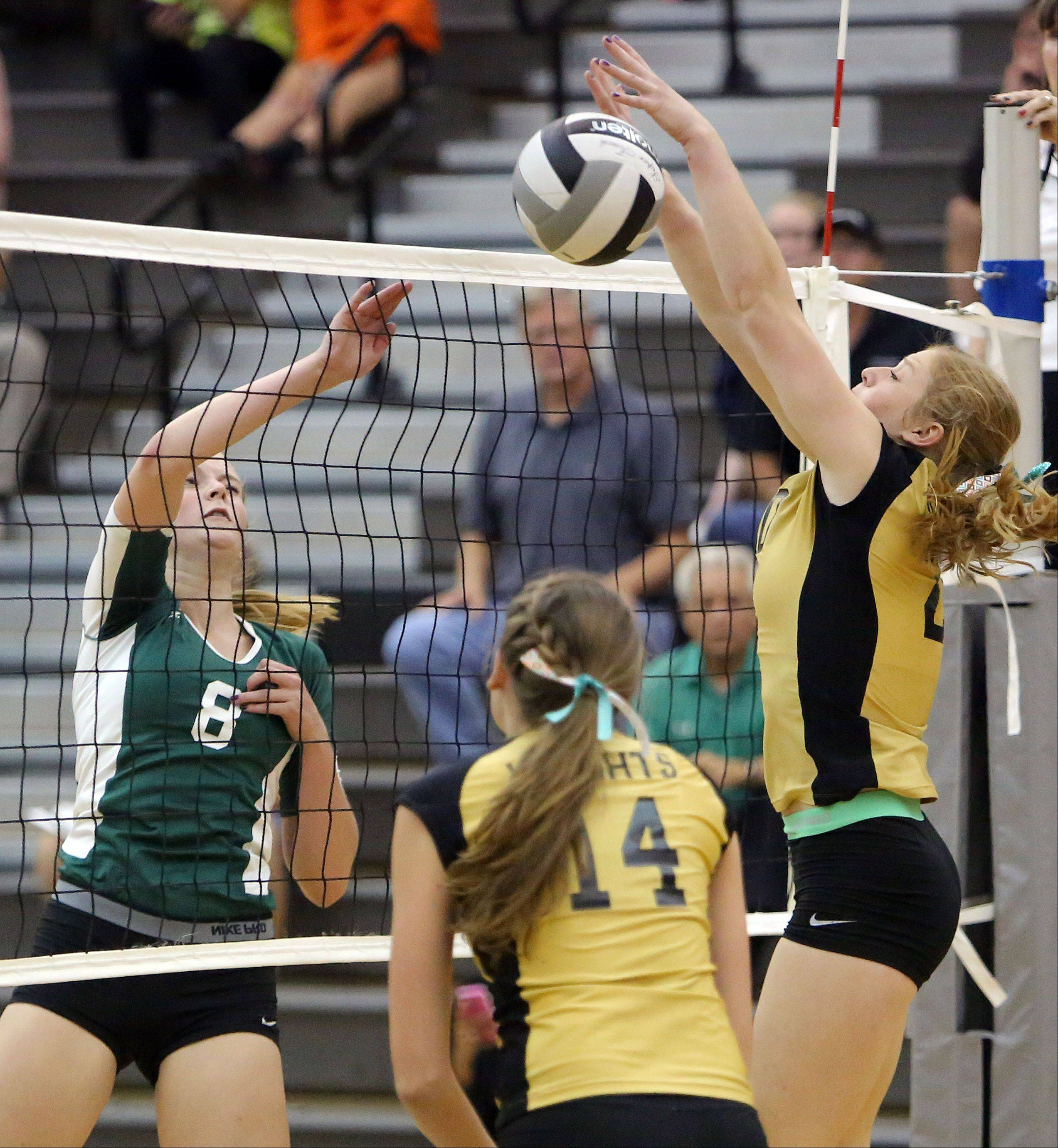 Grayslake Central's Alexandra Dahlstrom, left, and Grayslake North's Bailee Hardy meet at the net Tuesday at Grayslake North.