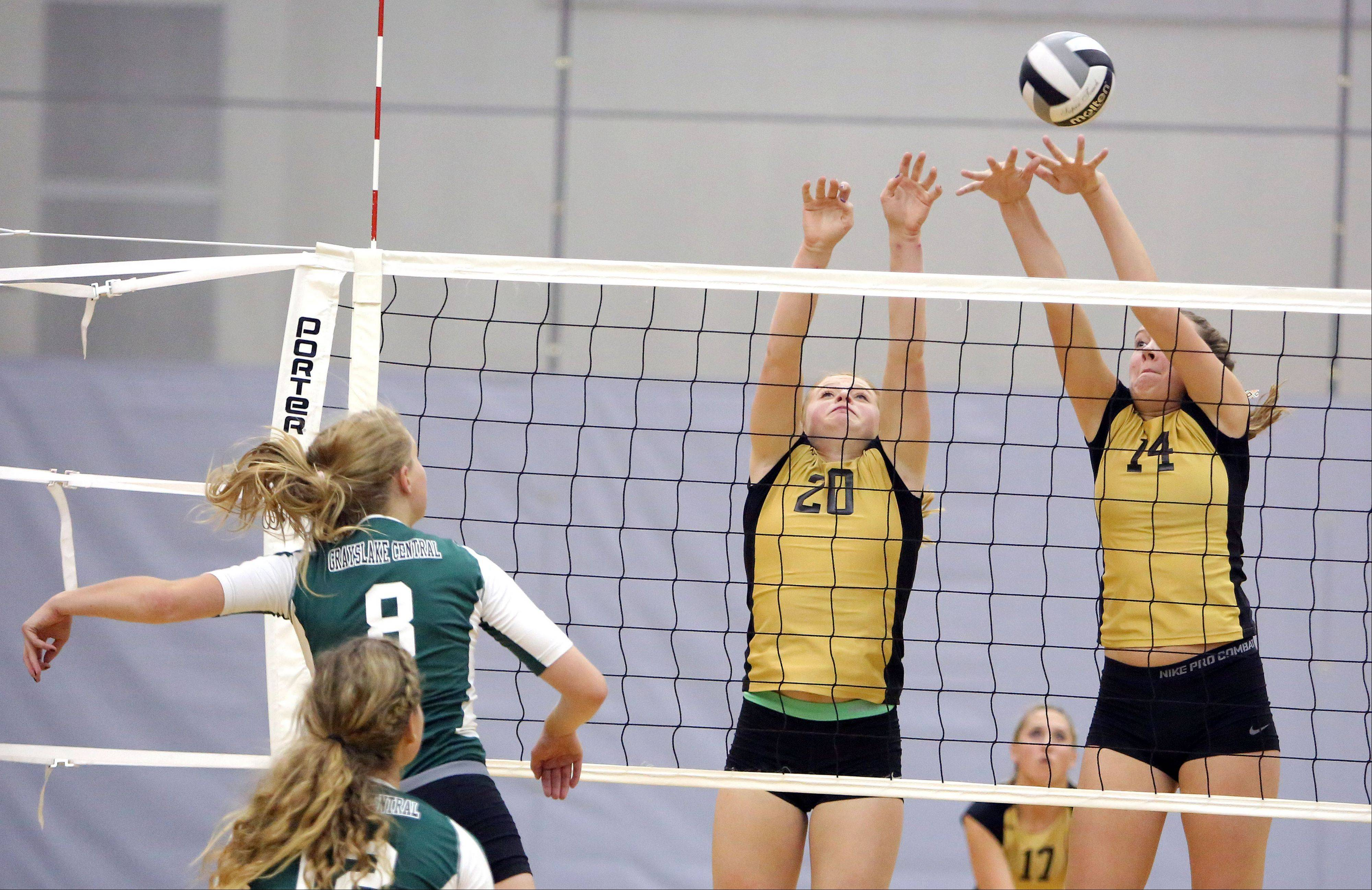 Grayslake Central's Alexandra Dahlstrom, left spikes one at Grayslake North's Bailee Hardy and Alaina Geissberger on Tuesday at Grayslake North.