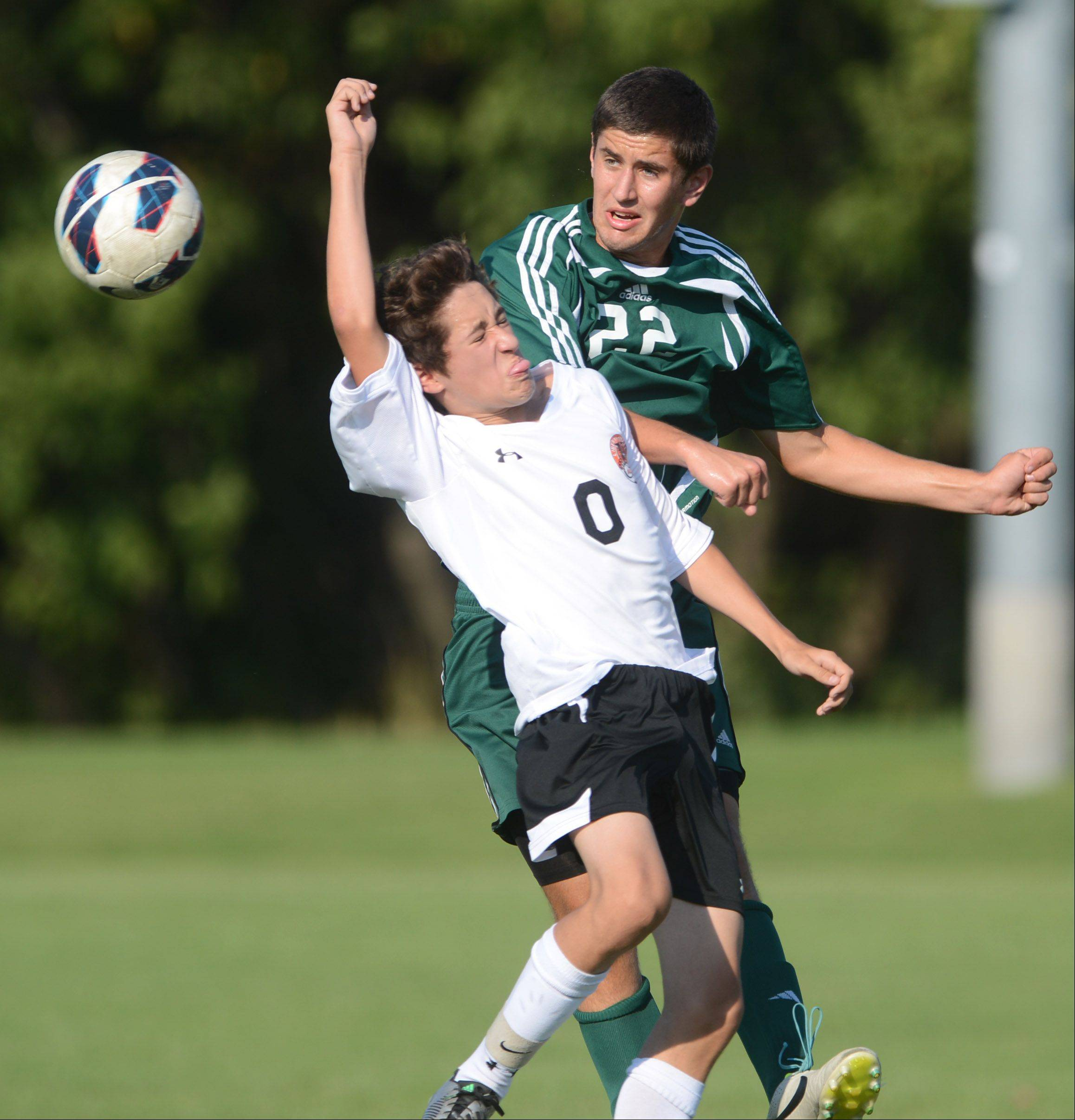 Libertyville's Kenny Gallagher (0) and Stevenson's Ethan Marx collide while chasing down a loose ball during Tuesday's soccer match in Libertville.