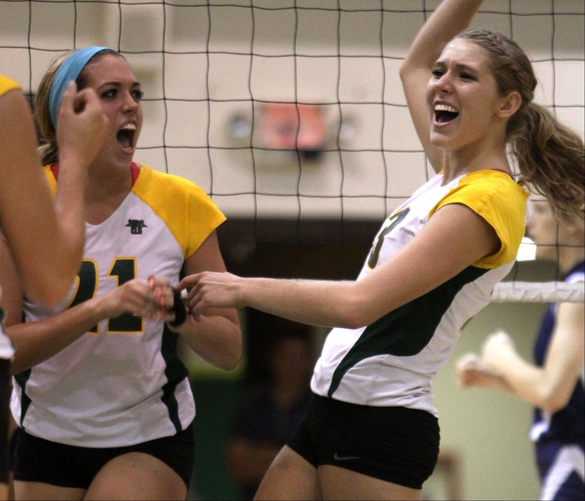 Crystal Lake South's Katy Hoenle, left, and Sara Mickow celebrate their victory over Cary-Grove during Thursday's volleyball match in Crystal Lake.