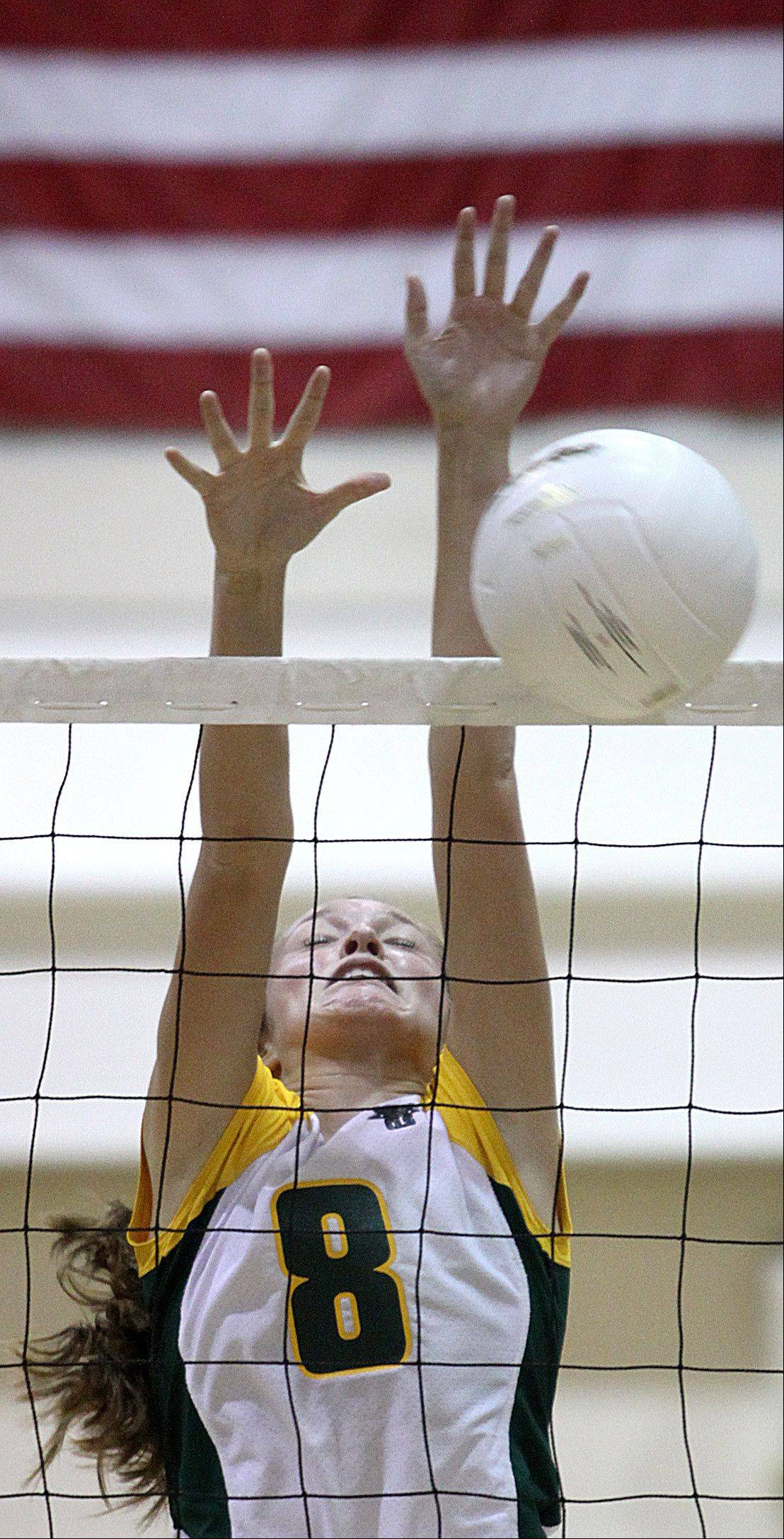 Crystal Lake South's Cassy Sivesind blocks the ball during Thursday's vollebay game against Cary-Grove.