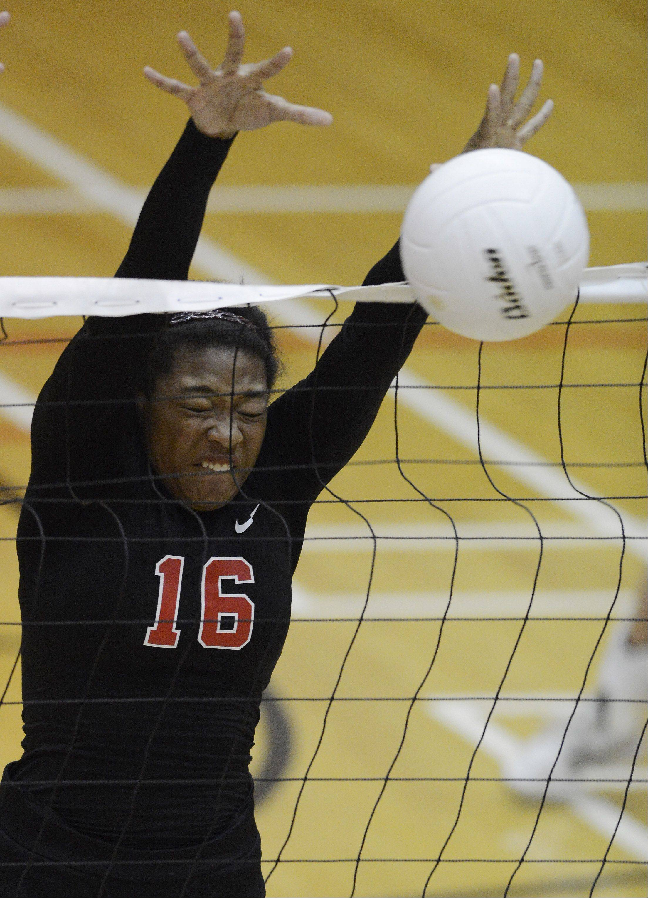 Palatine's Ashley Shepard gets a block at the net during Tuesday's game against Conant.