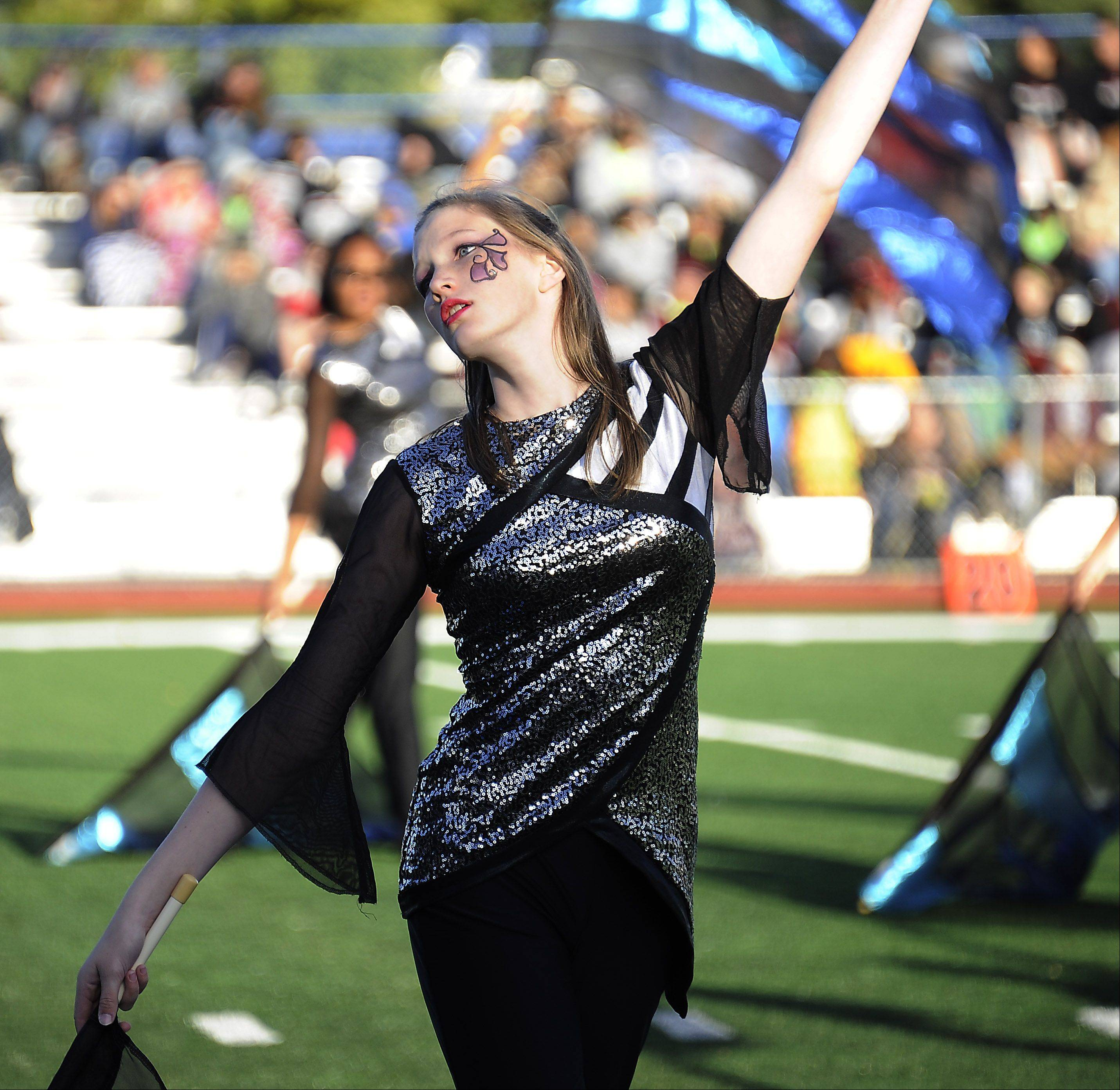 "Rolling Meadows High School's Danielle Sioui dances to ""Bright Lights, Hot Nights"" as the Mustang band plays behind her, in 2012."