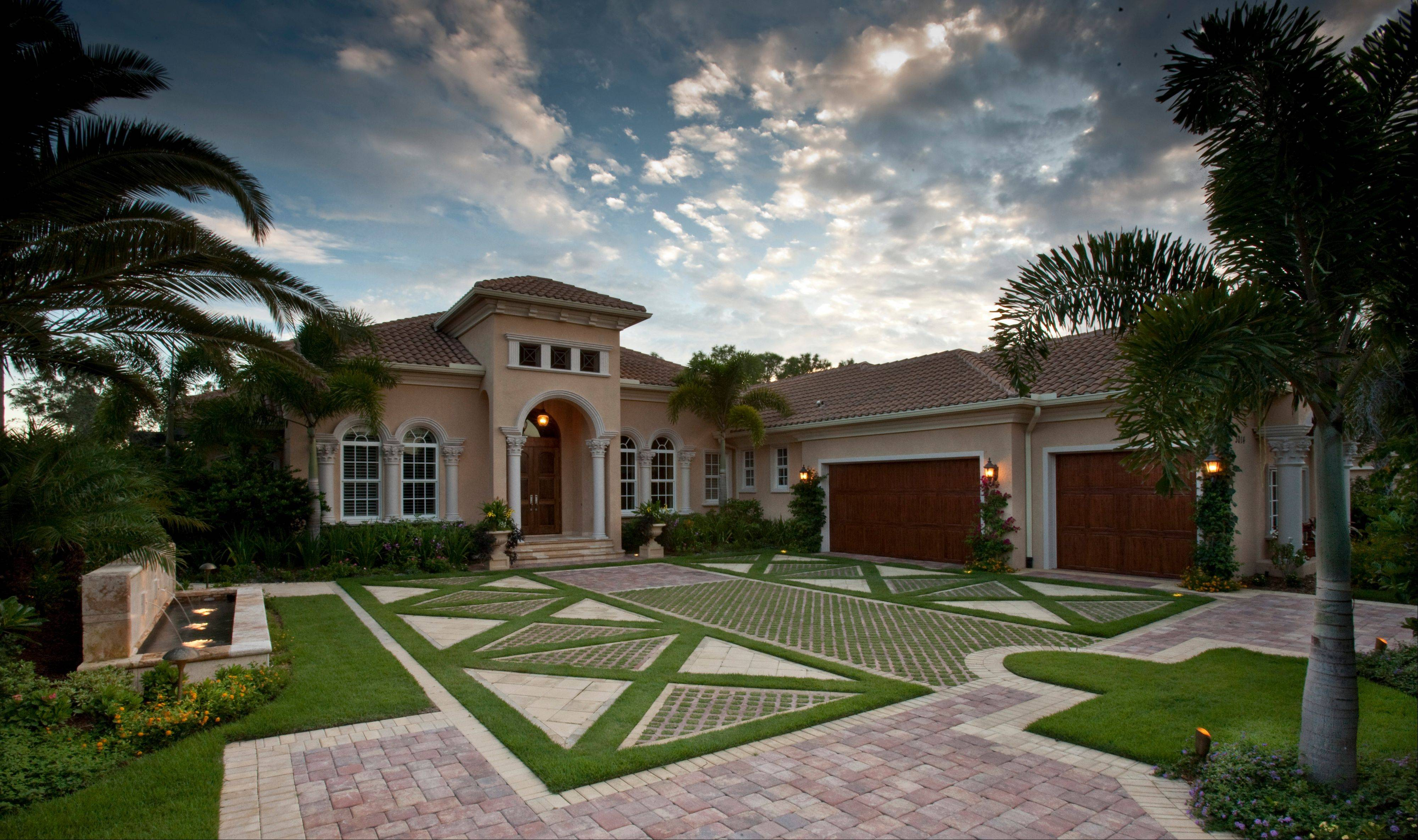 "In Naples, Fla., landscape architect W. Christian Busk installs ""living driveways,"" which feature real grass interspersed among pavers, which reduces heat and glare and provides some drainage."
