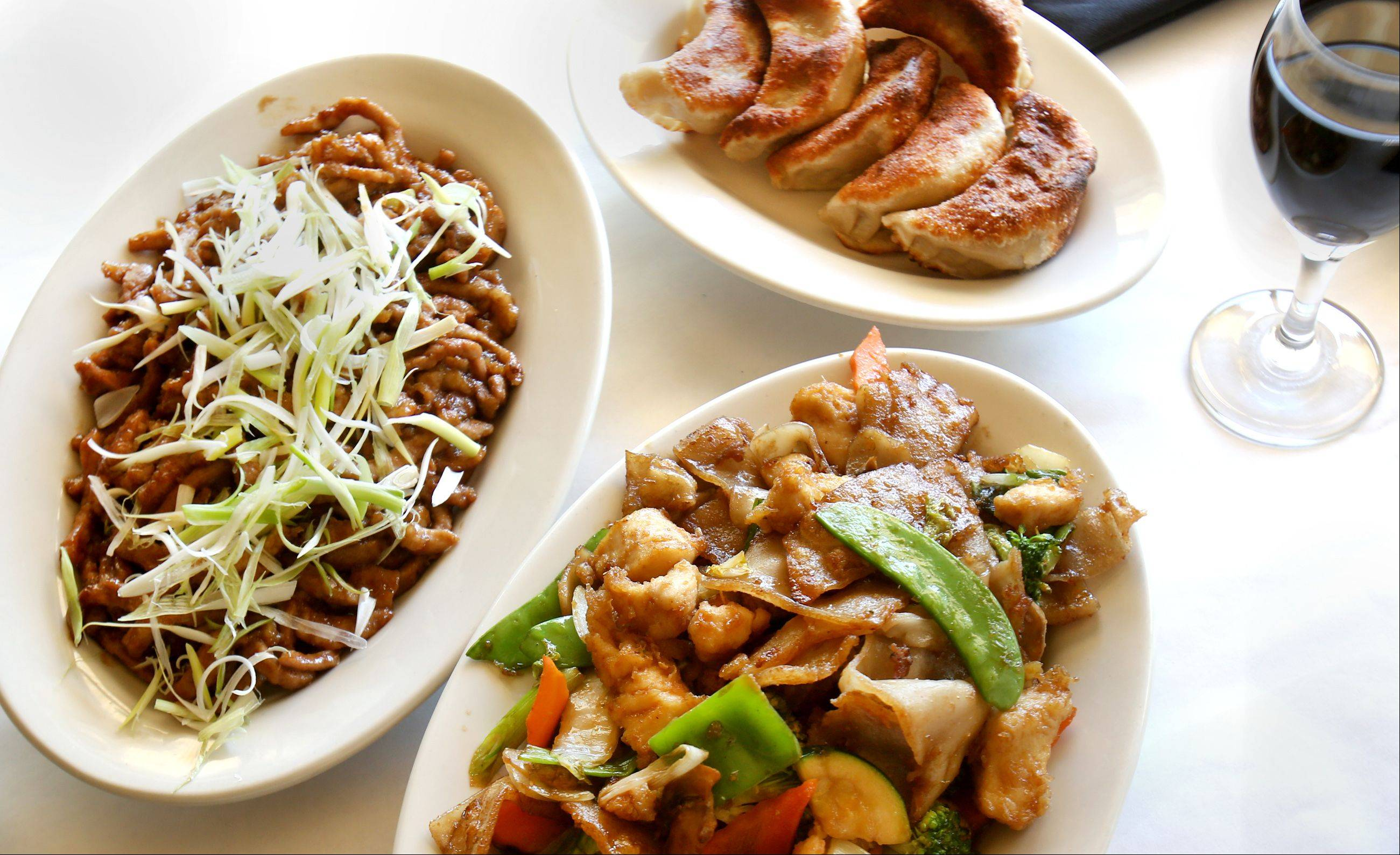 Mandarin pork, chicken chow fun and pot stickers are a delicious trio at Hua Ting in Hinsdale.