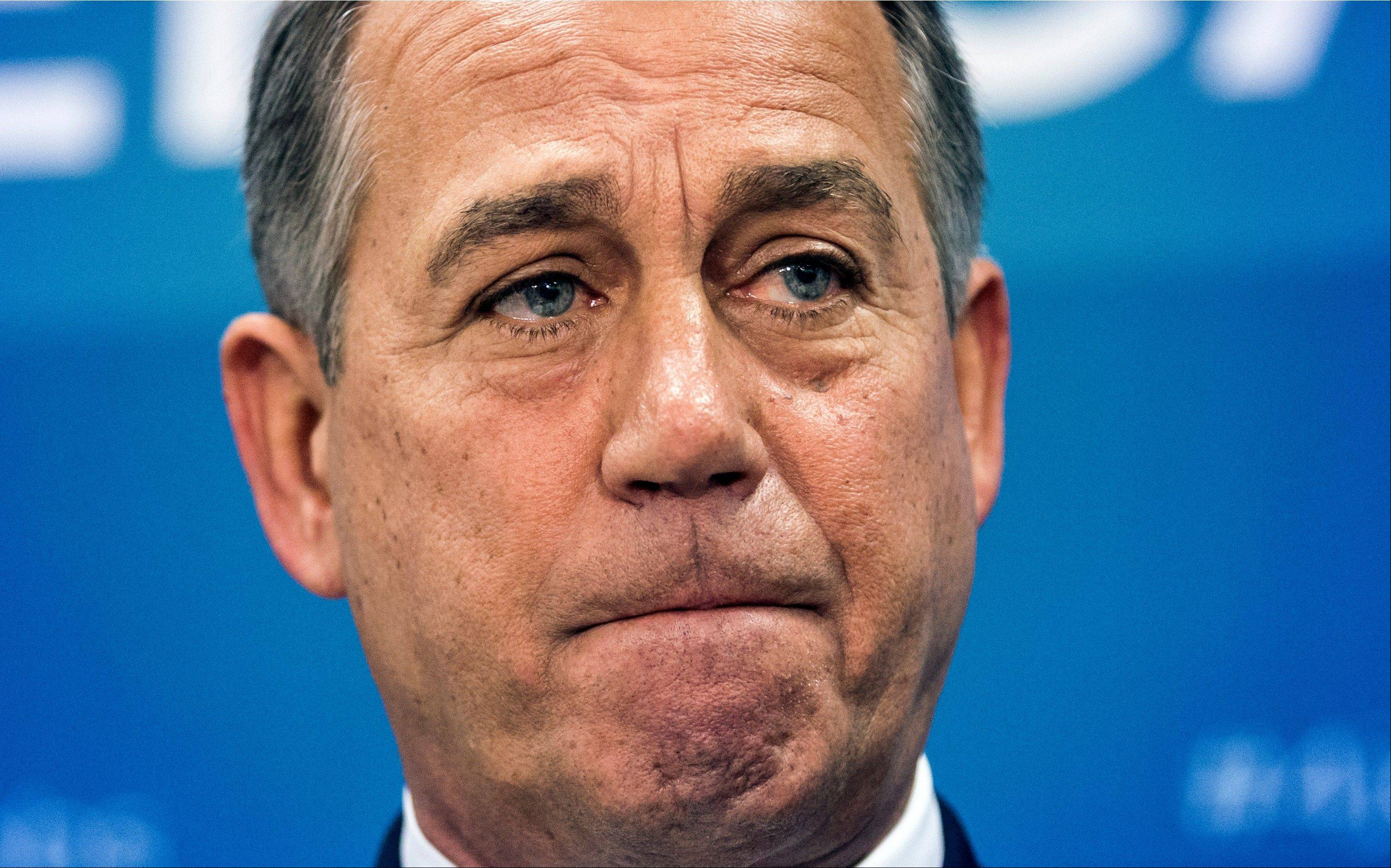 Speaker of the House John Boehner speaks with reporters after House GOP leaders looked to reverse course and agree to Tea Party demands to try to use a vote this week on a must-pass temporary government funding bill to block implementation of President Barack Obama�s health care law.