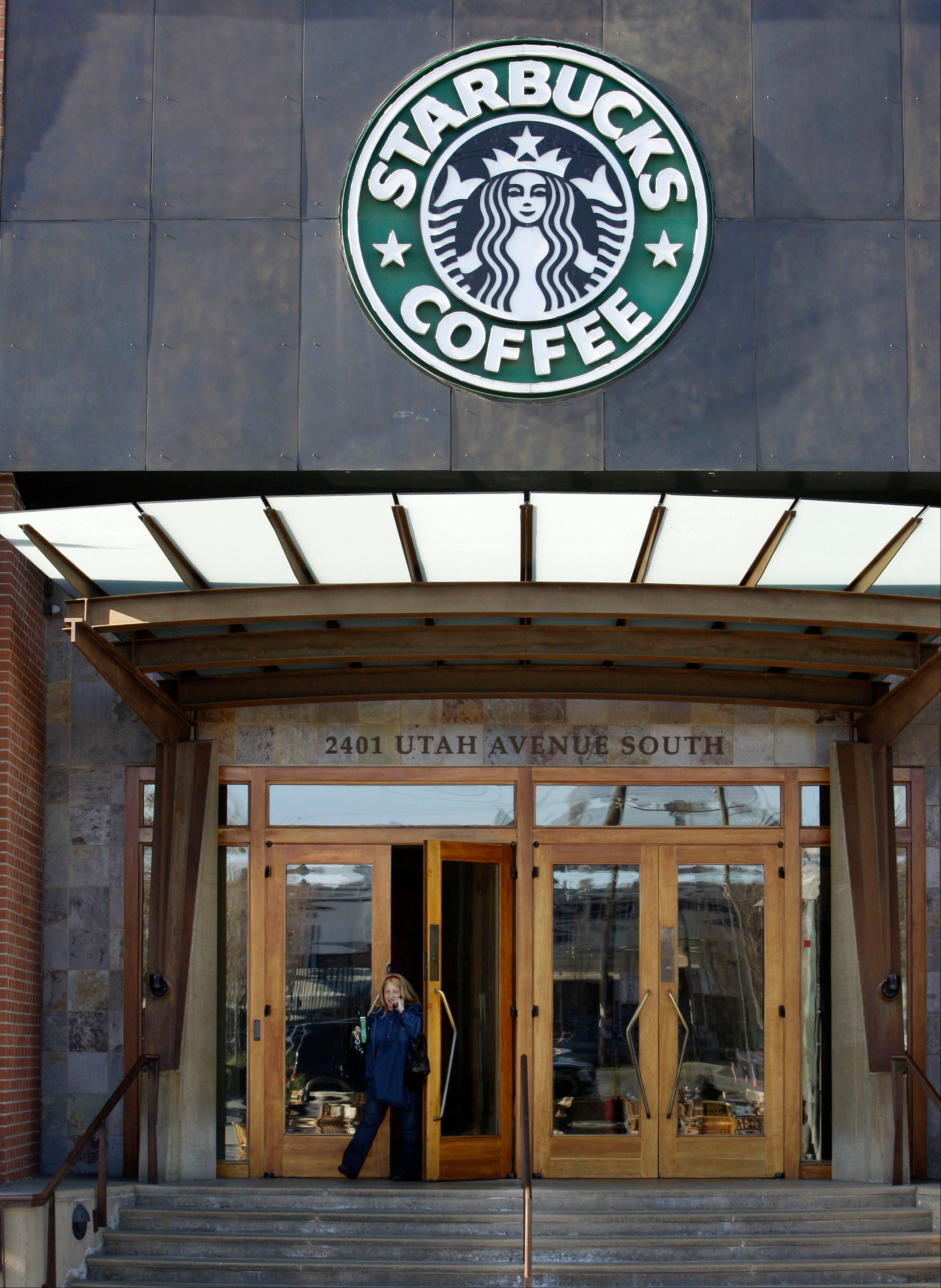 Starbucks says guns are no longer welcome in its cafes, though it is stopping short of an outright ban on firearms.