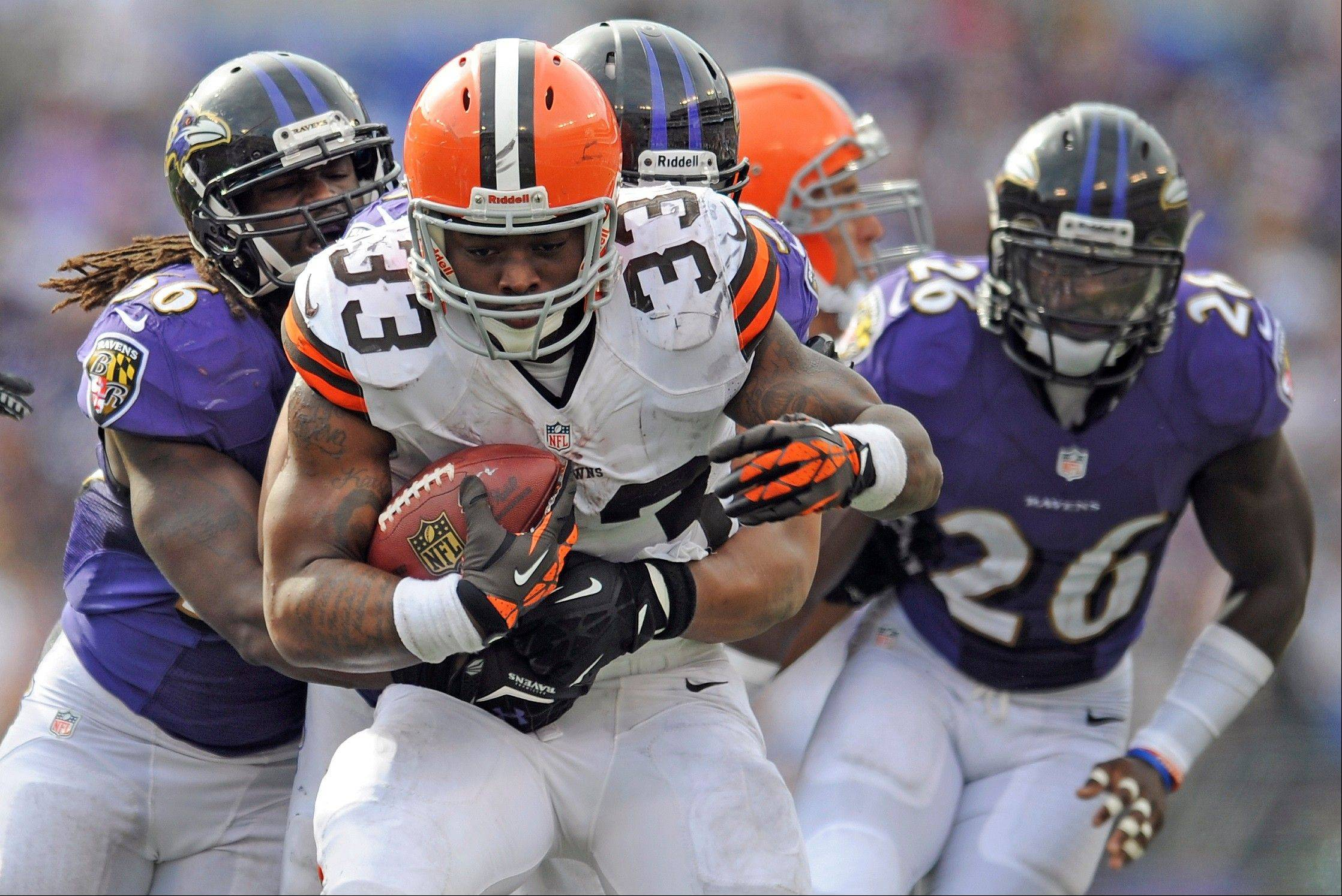 Cleveland Browns running back Trent Richardson carries the ball during an NFL football game against the Baltimore Ravens in Baltimore. The Browns have traded Richardson to the Indianapolis Colts in a surprise move less than two years after drafting him in the first round. The Browns (0-2), struggling on offense under new coach Rob Chudzinski, announced the move Wednesday afternoon, Sept. 18. They will also bring in veteran running back Willis McGahee for a physical.