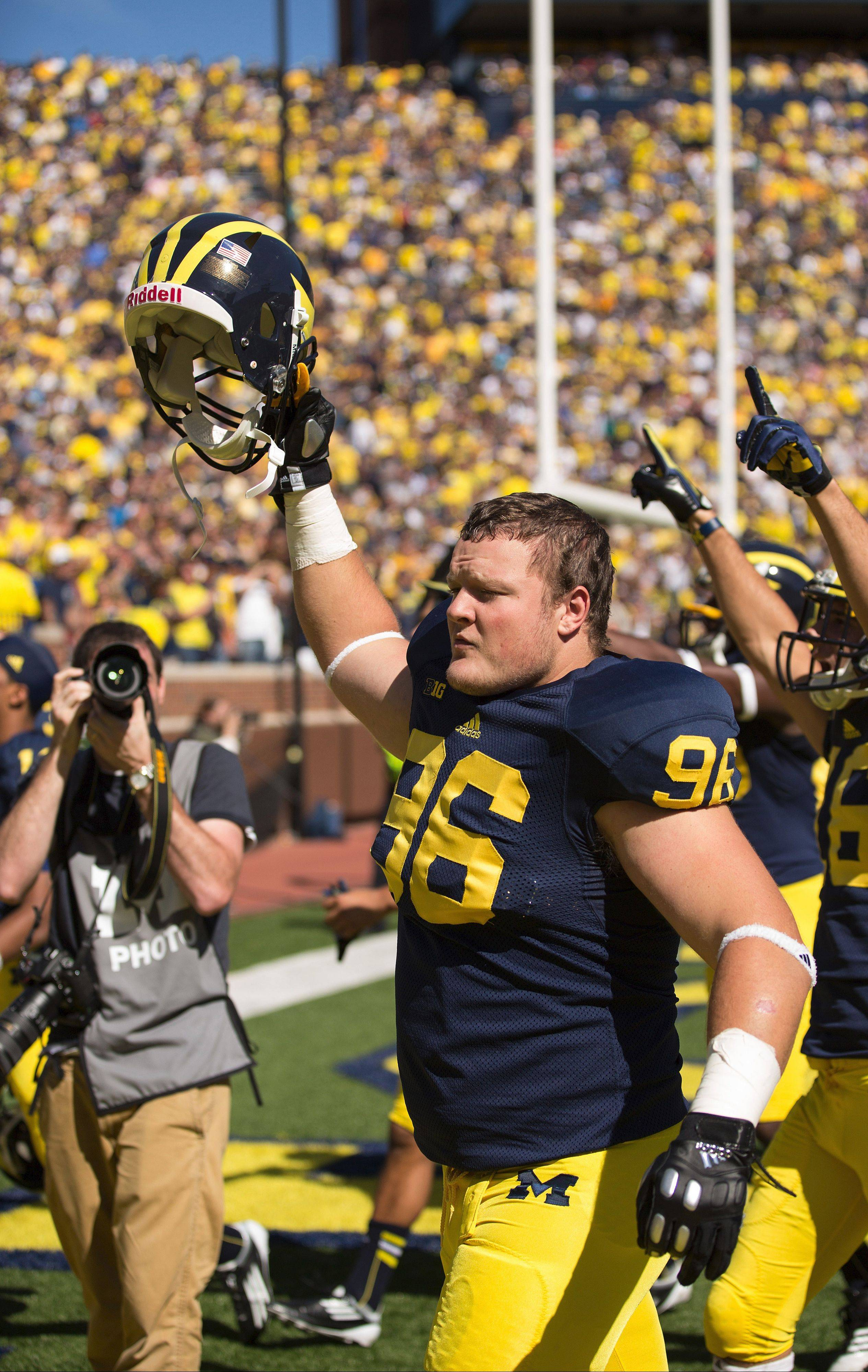 Marmion graduate Ryan Glasgow celebrates Michigan�s 28-24 win over Akron.