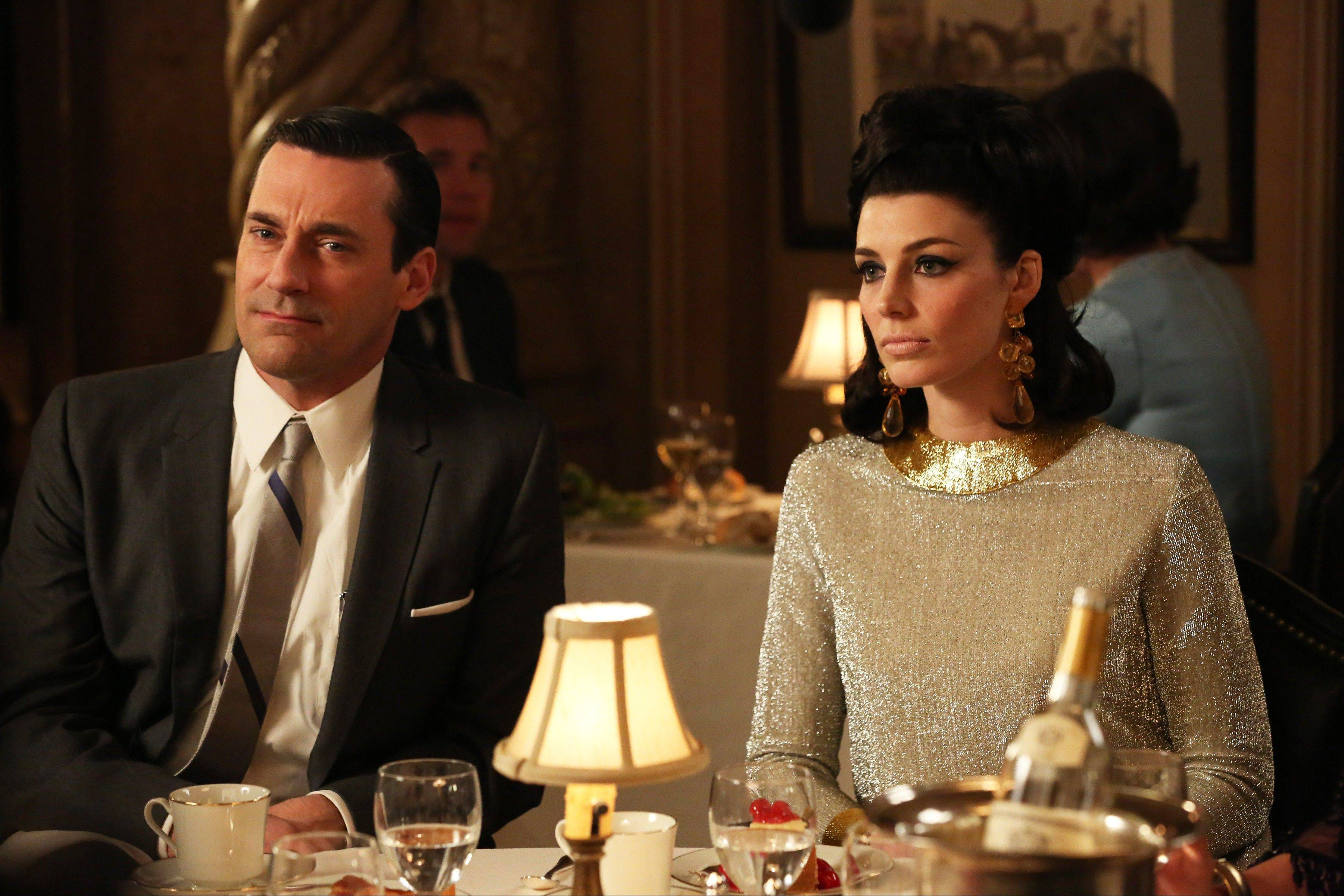 "AMC is keeping ""Mad Men"" -- starring Jon Hamm as Don Draper, left, and Jessica Pare as Megan Draper -- around an extra year, expanding the final season of this acclaimed drama series to 14 episodes and portioning them equally in 2014 and 2015."