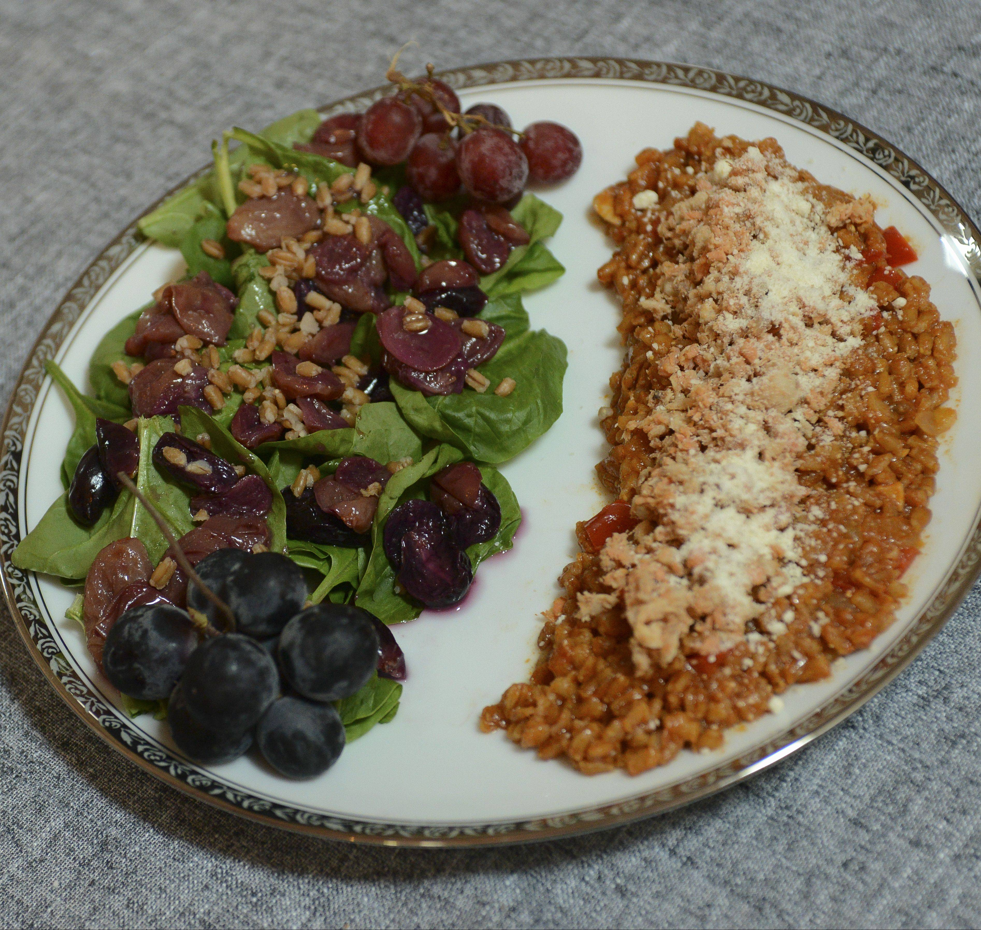 Carrie Shawala cooked farro like risotto, topped it with canned salmon and paired it with a sauteed grape salad.