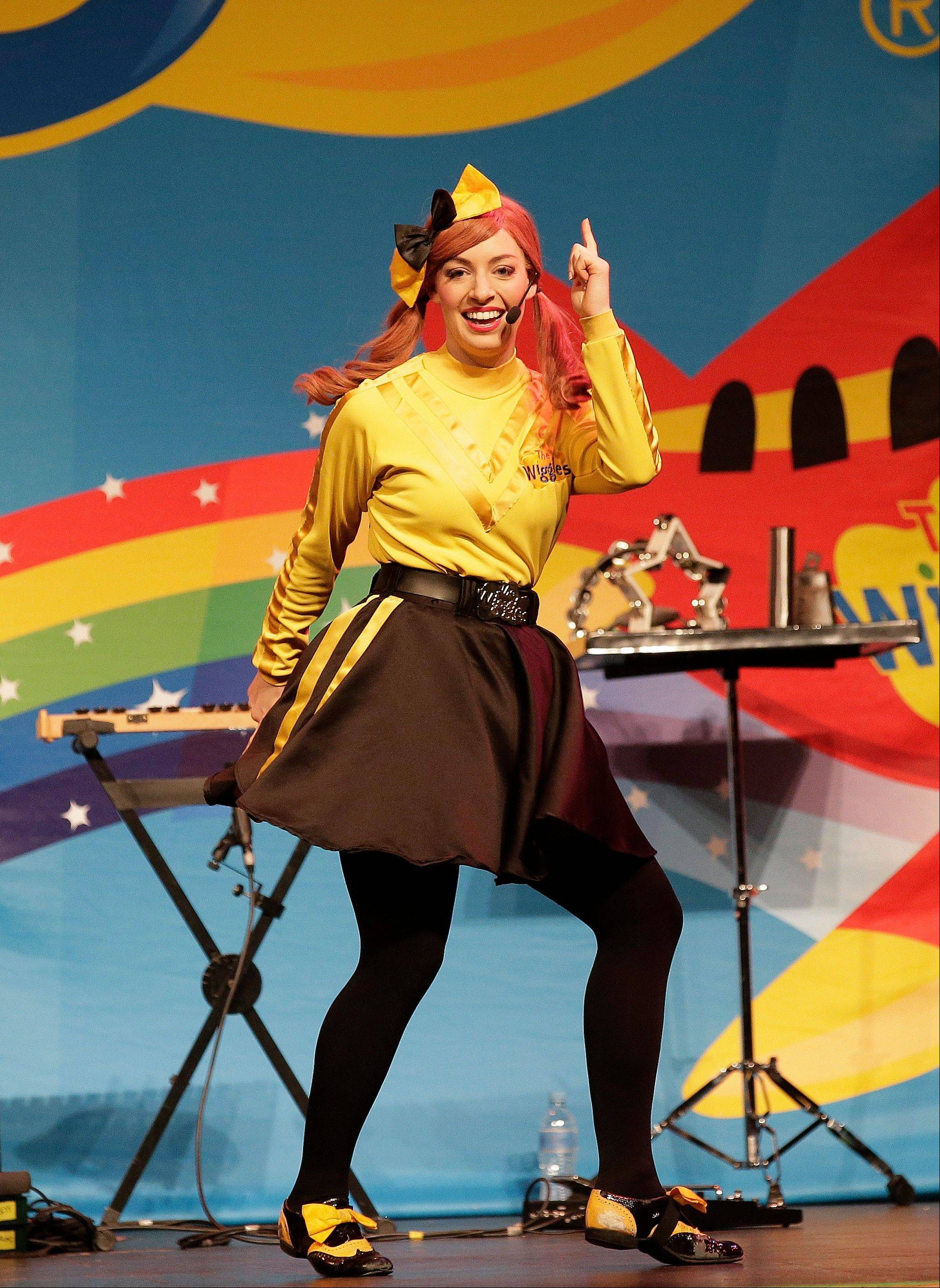 "Emma Watkins is the first woman to join The Wiggles. The newly reconfigured children's rock band plays the Rosemont Theatre in the show ""The Wiggles Taking Off! Live in Concert"" on Saturday, Sept. 21."